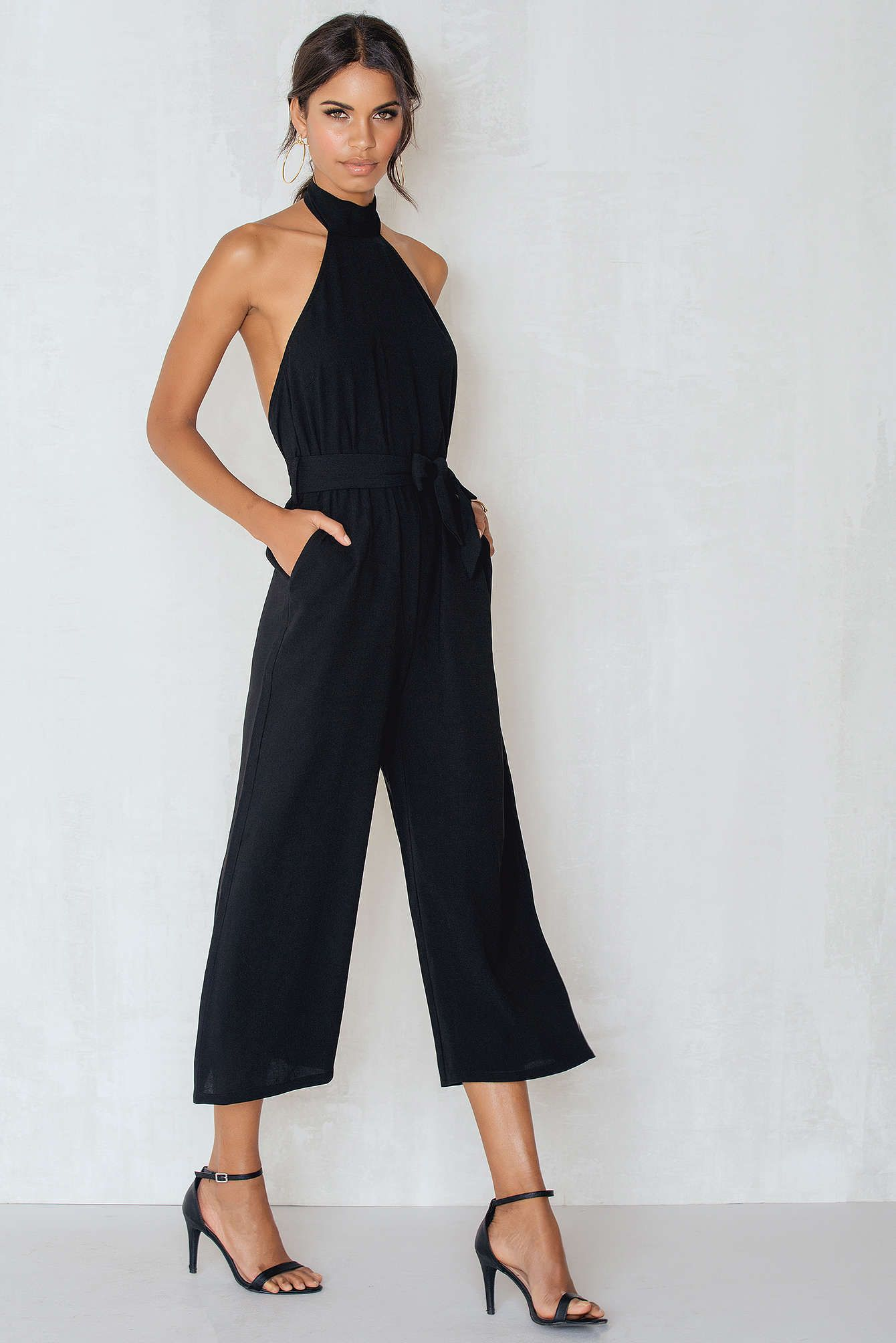 3e813f6a69bc Love jumpsuits! The Culotte Tie Neck Jumpsuit by NA-KD trend comes in black  and features the perfect jumpsuit