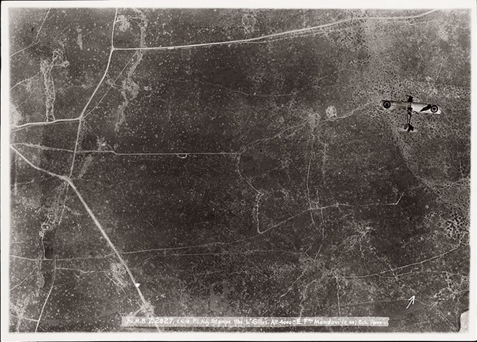 A Breguet 14, a bi-plane bomber and reconnaissance aircraft, is photographed over enemy territory in Kortekeer in 1918. (All photos:Courtesy Yale University Press/ Mercatorfonds)