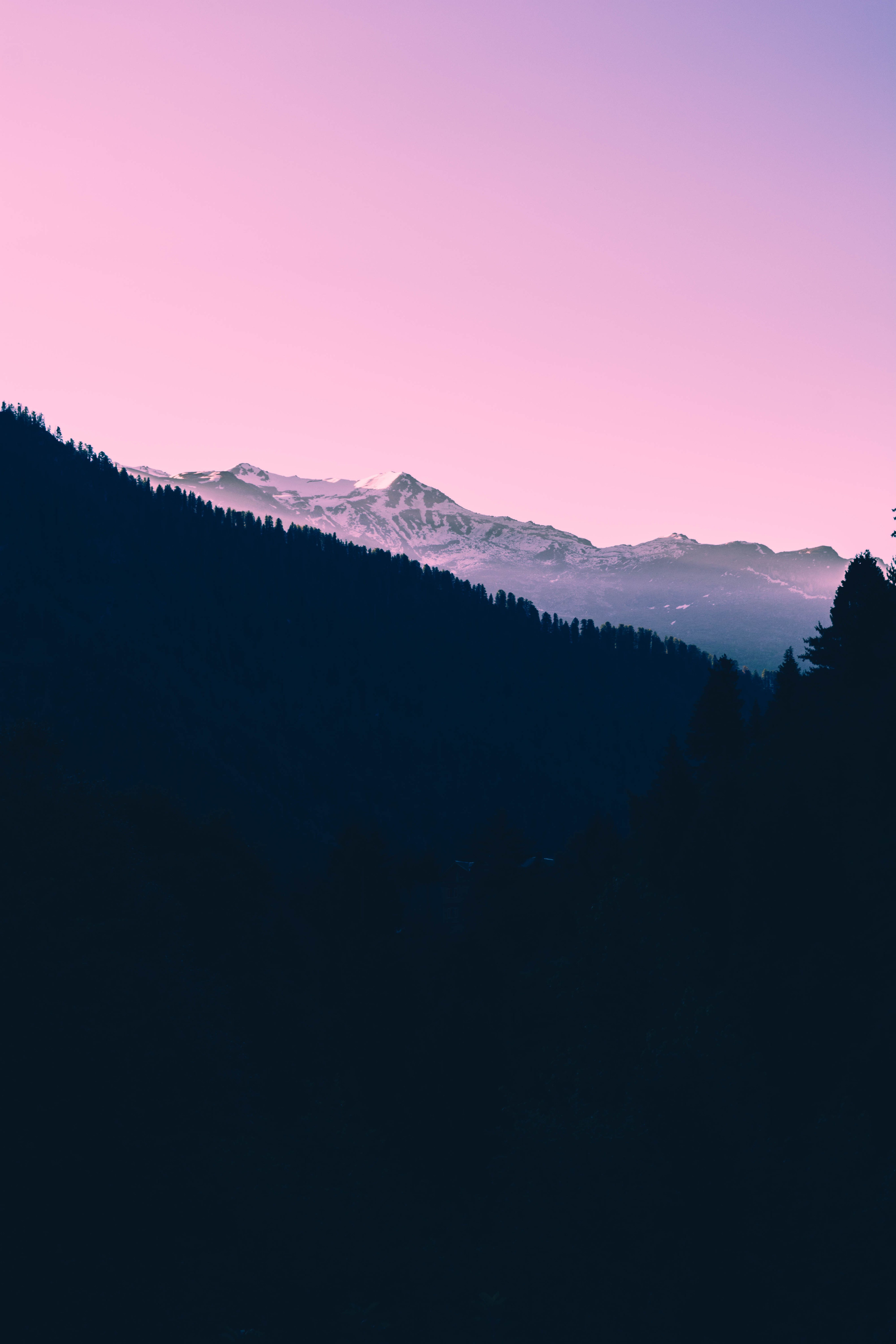 A Dark Sunset Over Snow Covered Mountains And A Pink Sky Tumblr