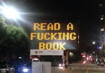 """Google+L.A. Traffic Sign Is Hacked to Say """"Read a F——ing Book"""" (PHOTOS) buff.ly A downtown Los Angeles digital traffic sign was apparently hacked recently to state, """"READ A FUCKING BOOK."""" L.A. Weekly contributor Daina Beth Solomon s..."""