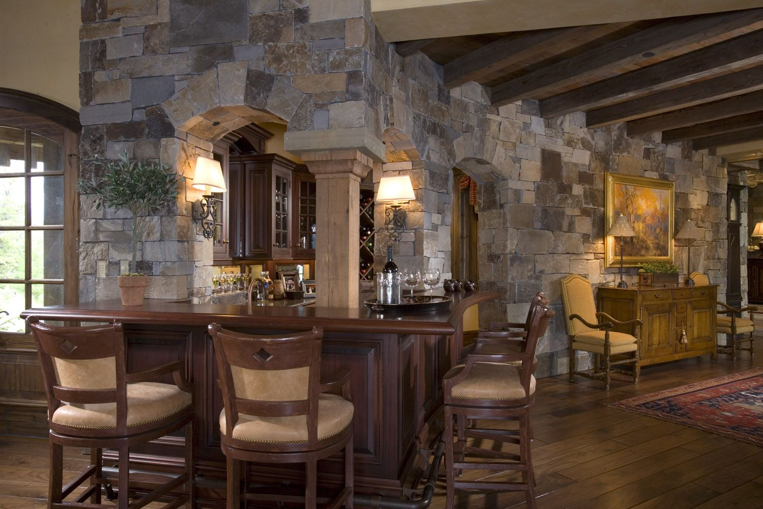 wood beam ceiling wood floors stone wetbar mountain lodge in wood beam ceiling wood floors stone wetbar mountain lodge in yellowstone club designed by locati interiors wine rooms and wet bars pinterest