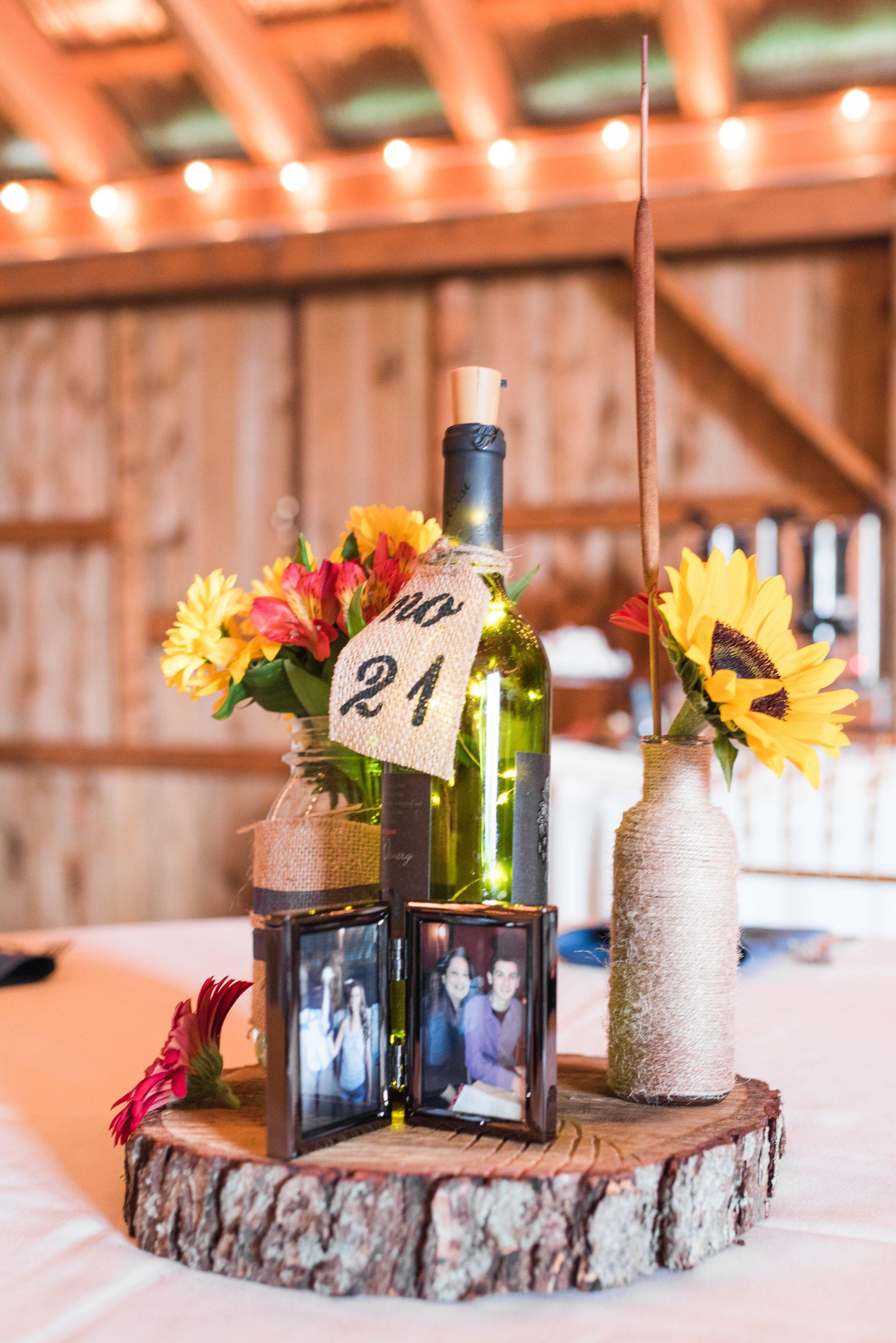 Rustic barn wedding reception decor, wine bottles and sunflowers ...