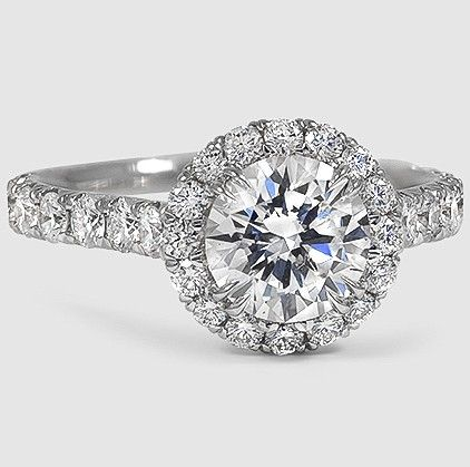 French pavé set diamonds form a stunning halo in the Sienna Diamond Ring.