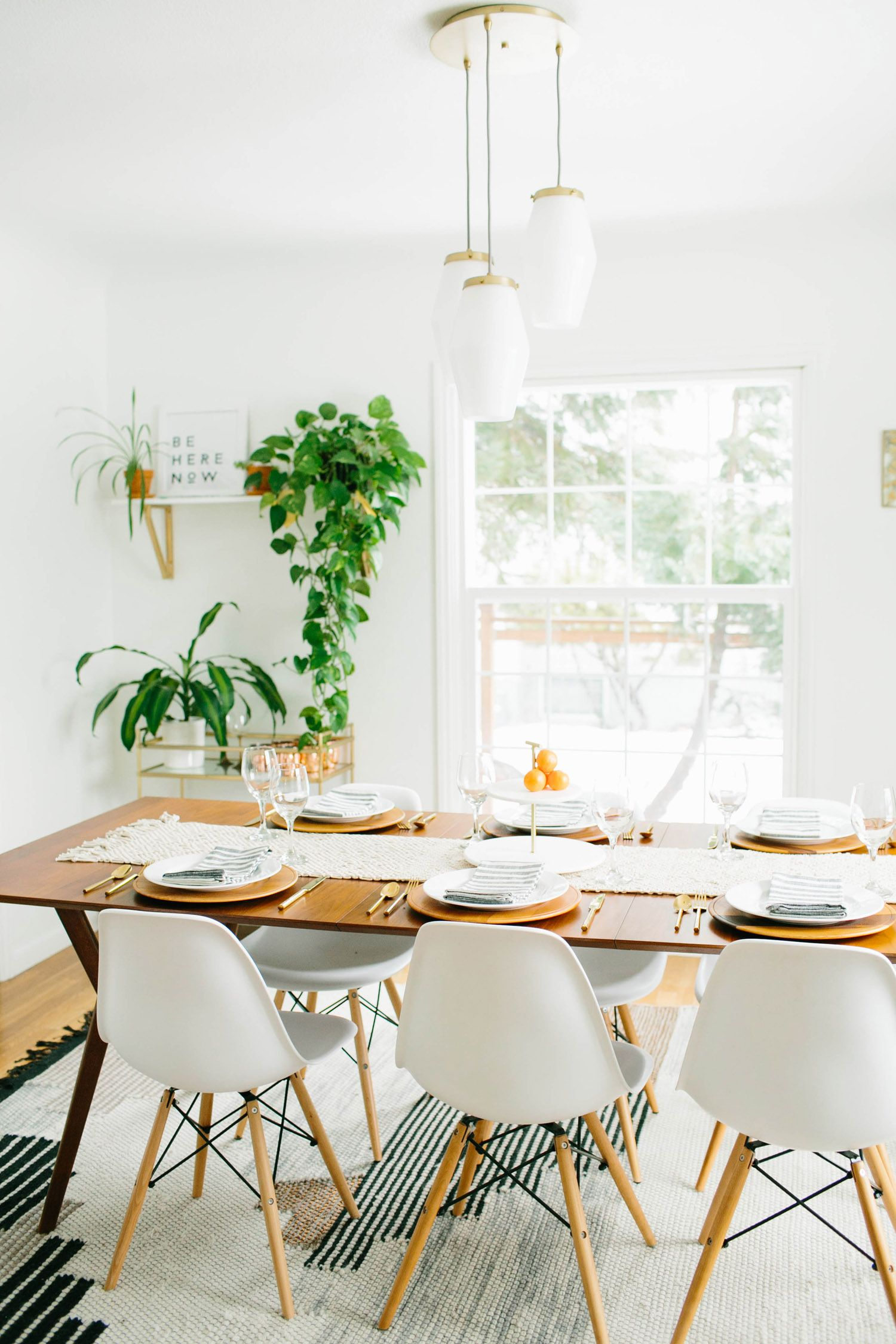 Dining Room With Long Wood Table Plants Simple Decor Fun Light