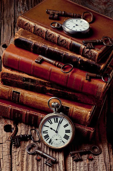 Old books and watches by Garry Gay