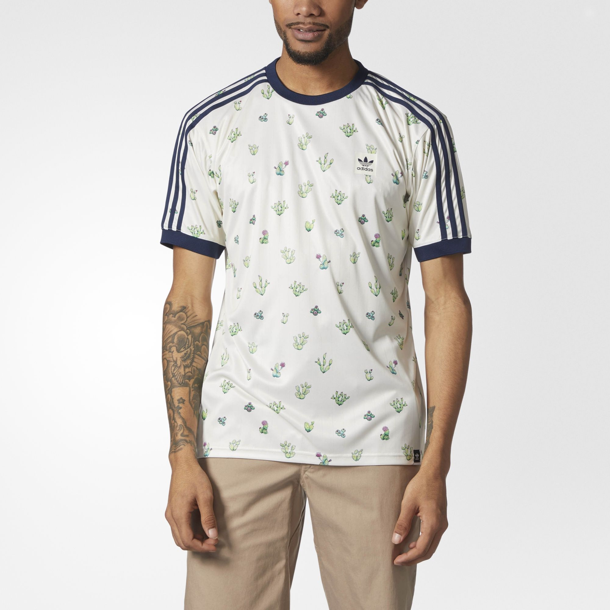 f14925ac097840 A soft jersey tee with a spiny look, this men's skate t-shirt flashes an  allover cactus print. 3-Stripes down the shoulders and an adidas Trefoil  logo over ...