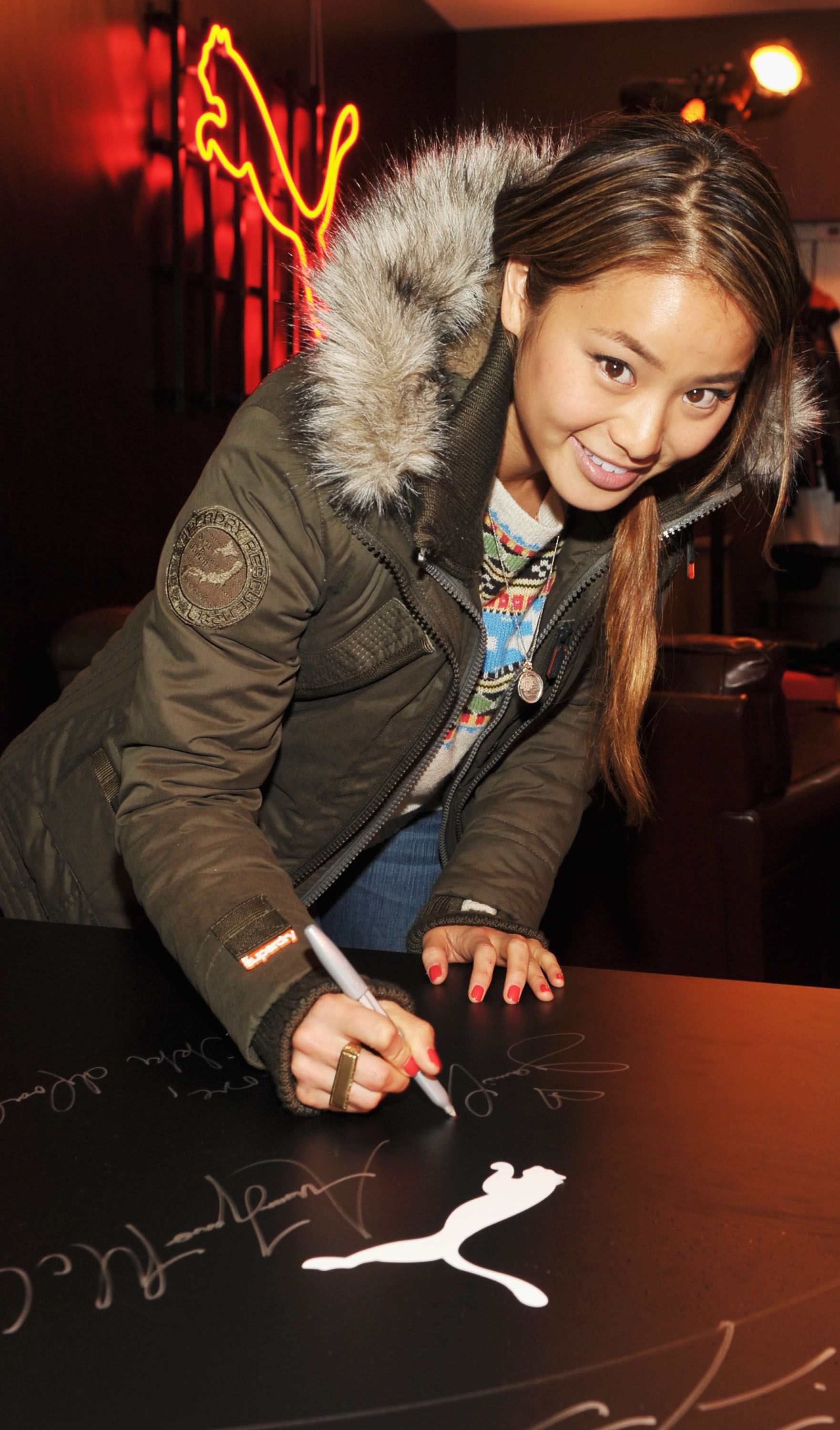 Jamie Chung in the Superdry patrol jacket. her sweater