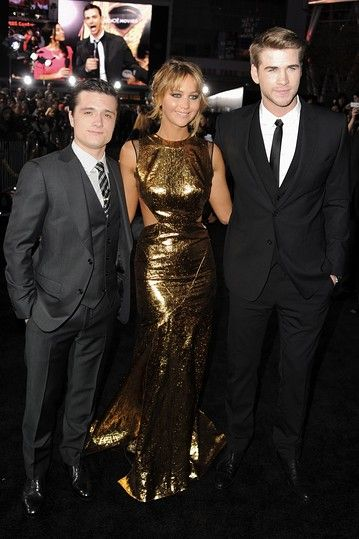 """Actors Josh Hutcherson, Jennifer Lawrence, and Liam Hemsworth arrive at the premiere of Lionsgate's """"The Hunger Games"""" in Los Angeles, California."""