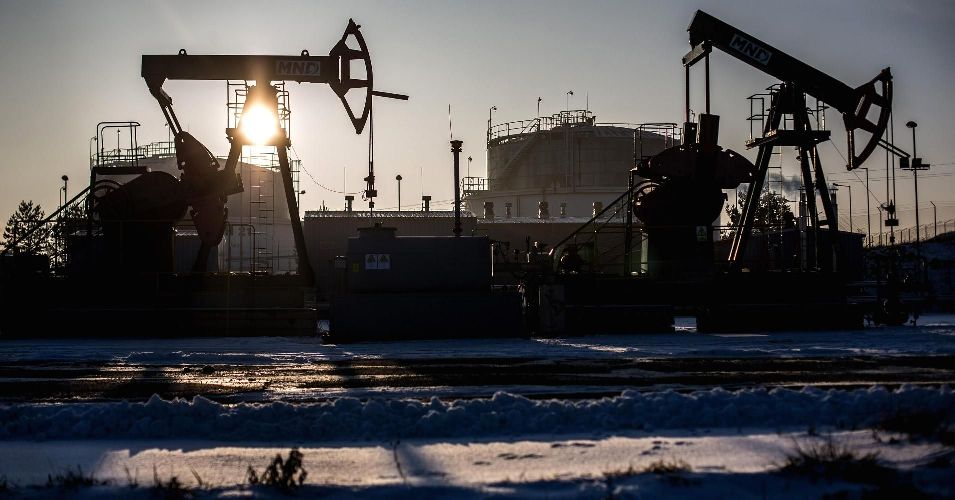 U.S. crude futures closed nearly 6 percent on Monday as weak economic data from China, the world's largest energy consumer, reversed a four-day rally from last week and an OPEC source undermined chances of an emergency meeting to stem the decline.