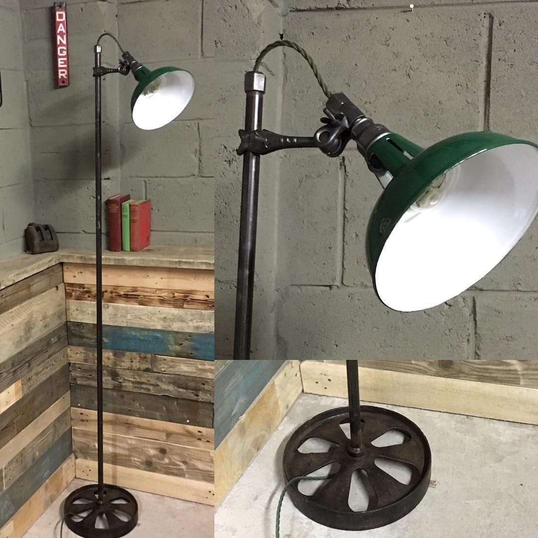 This adjustable floor lamp has a great vintage industrial look. Made from iron pipe with a 1930s factory enamel shade on an adjustable iron clamp. All mounted on a vintage cast iron wheel and wired with vintage style cord. SORRY SOLD. #stesupcycleworkshop #vintagelamp #interior-design #homedecor #enamel #floorlamp #vintageindustrial #industiallamp #steampunk #mancave