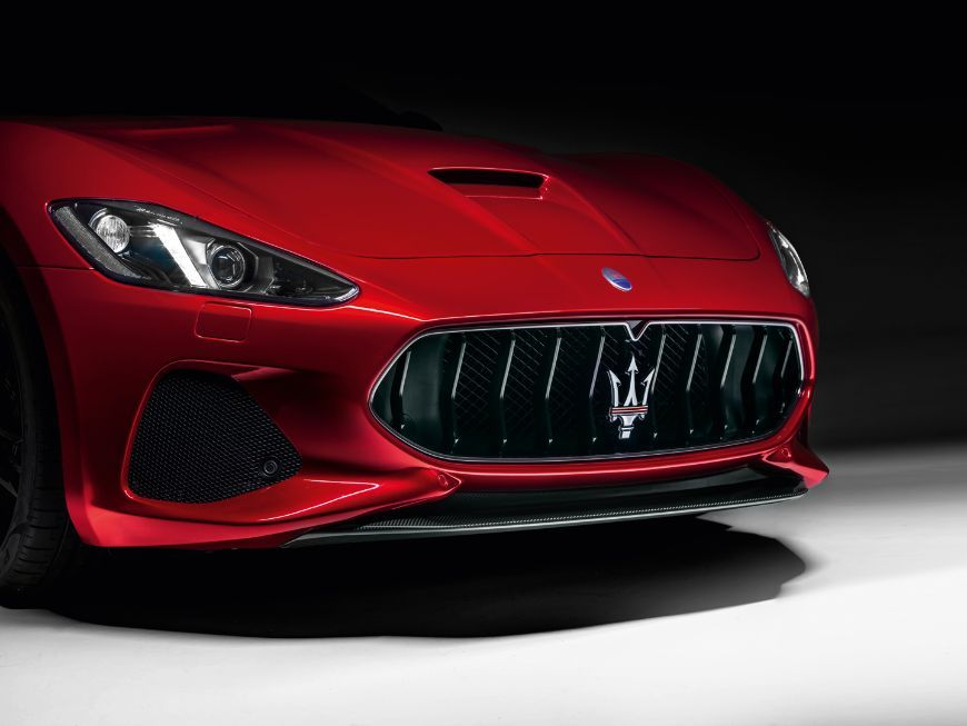 Red Maserati Granturismo Front Details With The Trident Emblem