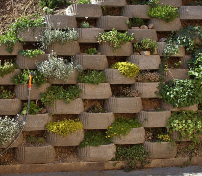 Block Retaining Wall With Small Decorative Plantings