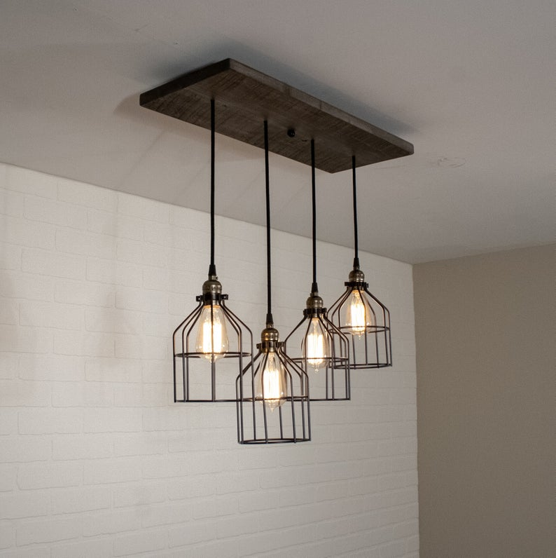 Wood Chandelier Lighting Rustic Kitchen Island Light Featuring 4 Edison Bulb Pendants With Cages Custom Edison Lighting In 2020 Rustic Light Fixtures Rustic Kitchen Island Lighting Fixtures Kitchen Island