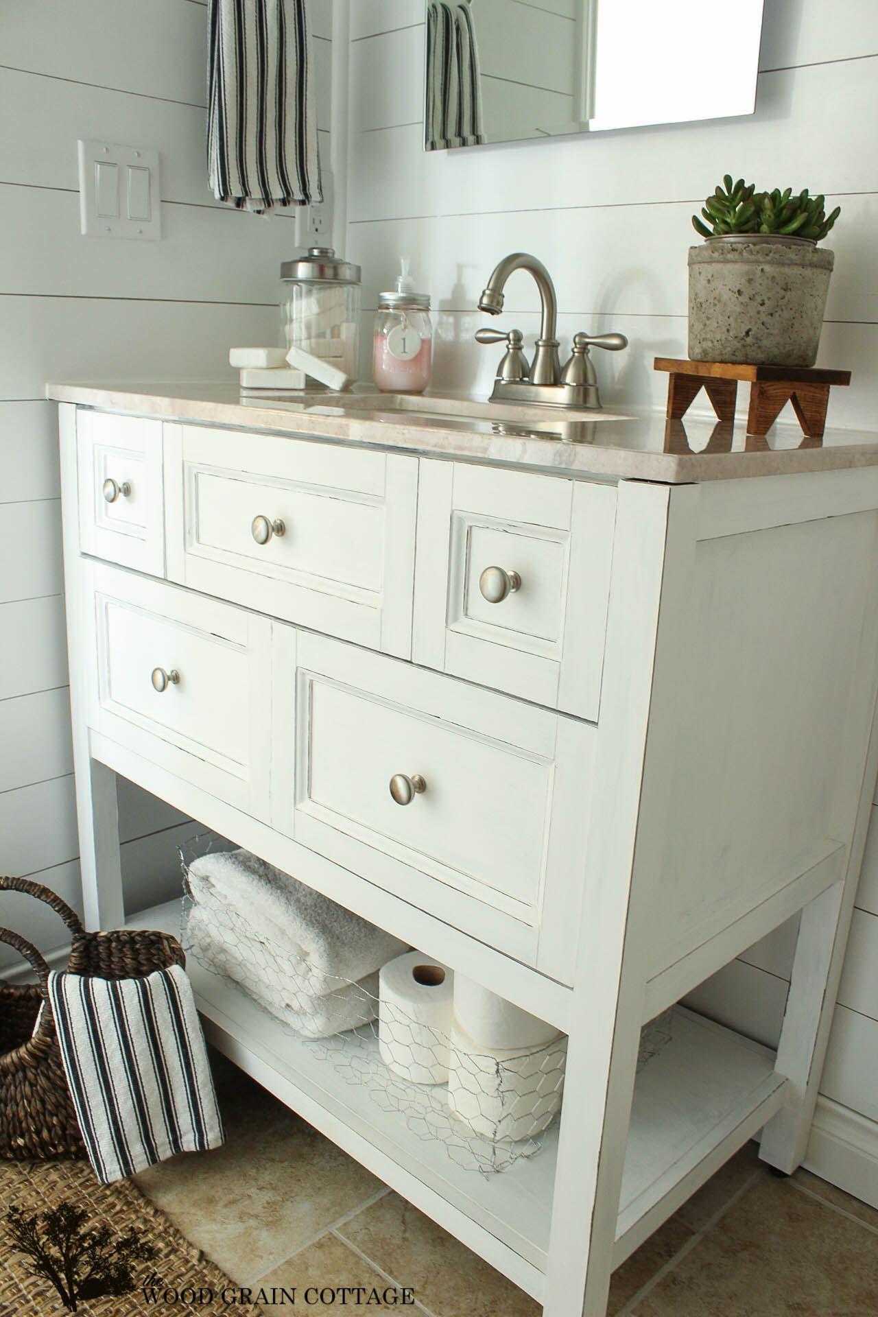 Basement Finishing Ideas: Open Bathroom Vanity With Baskets On Shelf For  Storage