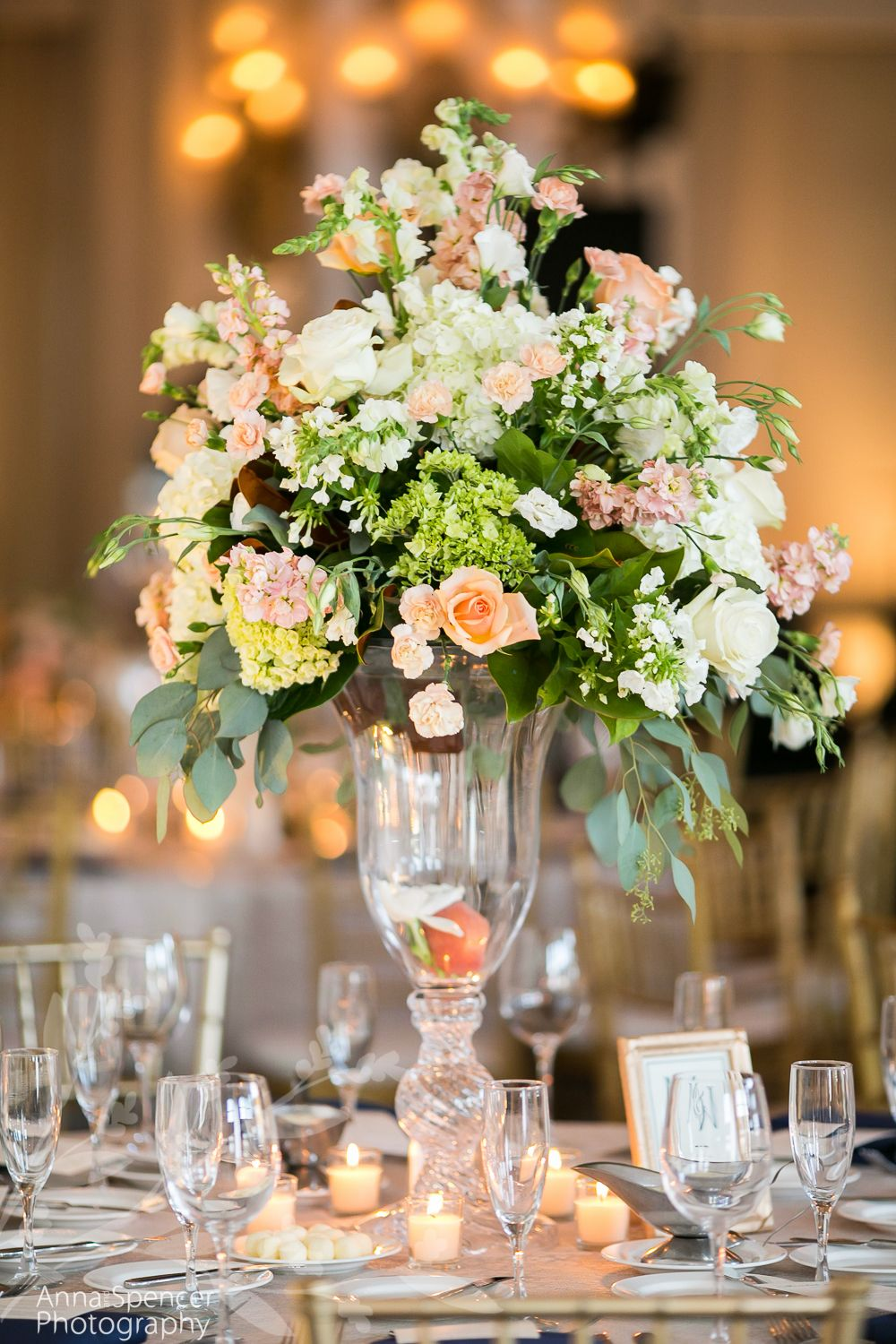 Peach And White Floral Table Arrangement In A Tall Glass Vase