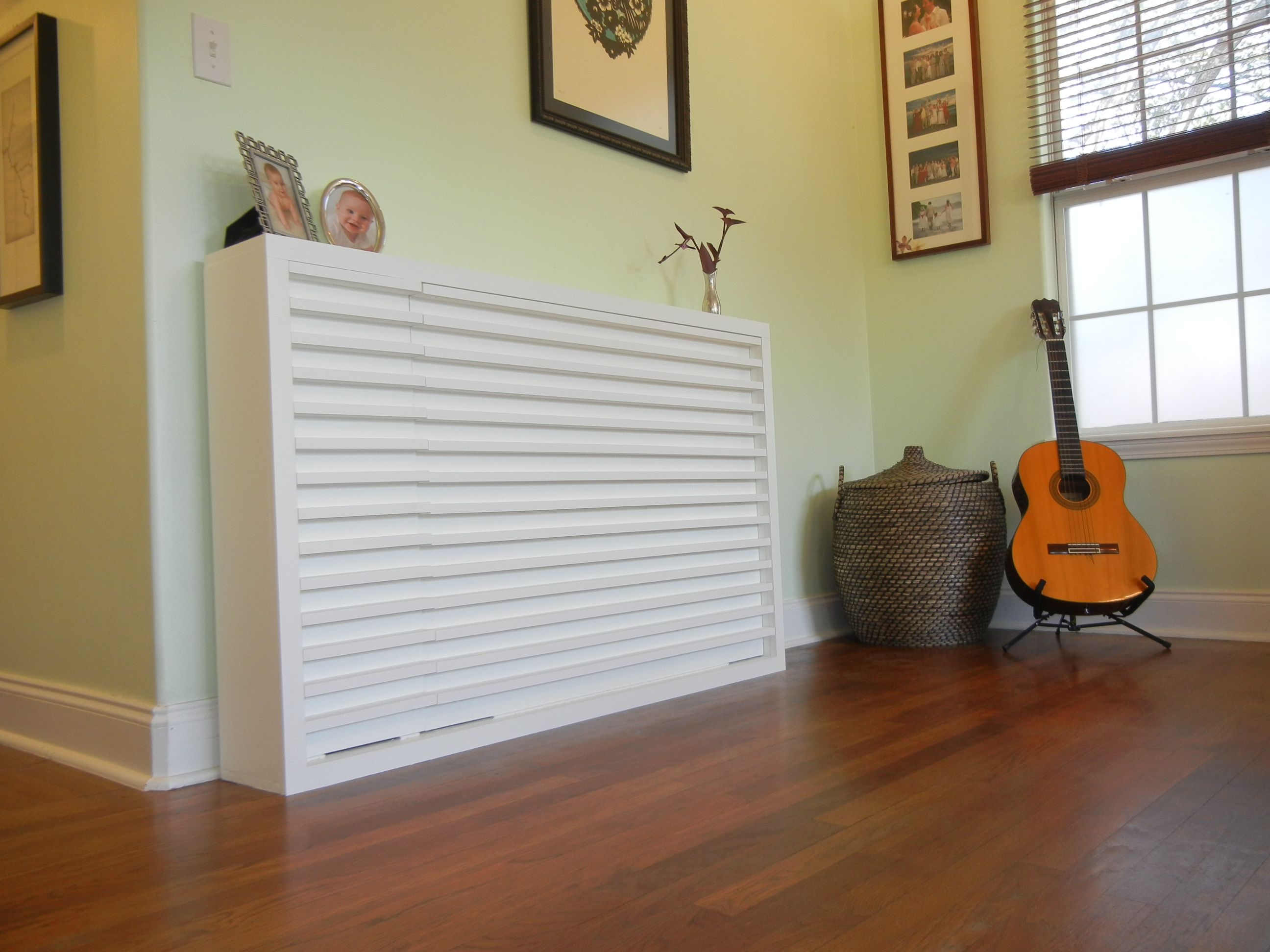 Bedroom. Simple Wooden Floor And White Murphy Bed On The