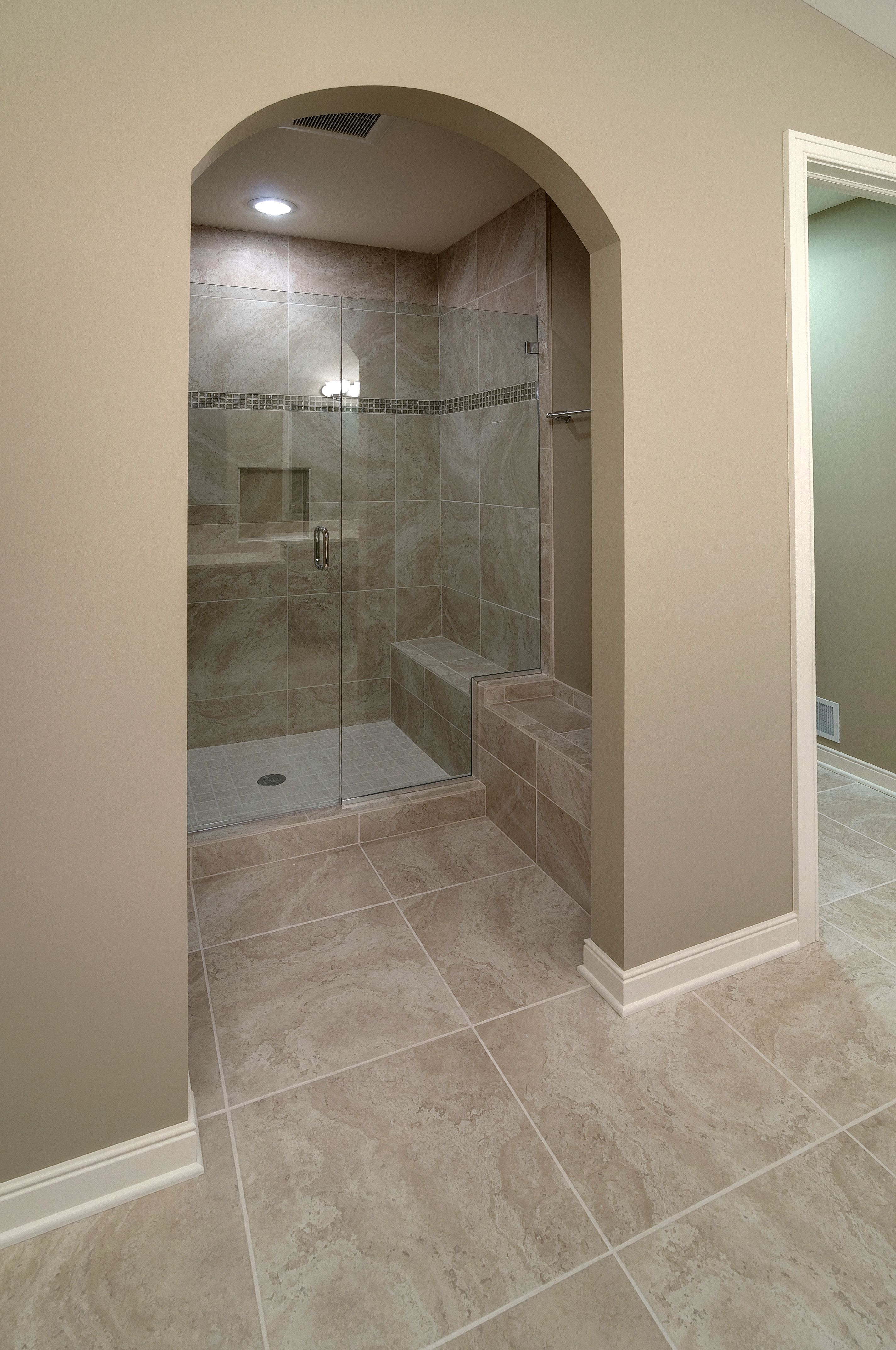 18 x18 Shaw Tivoli Color 100 flooring and shower wall tile. Restoration  Hardware Flat Cappuccino