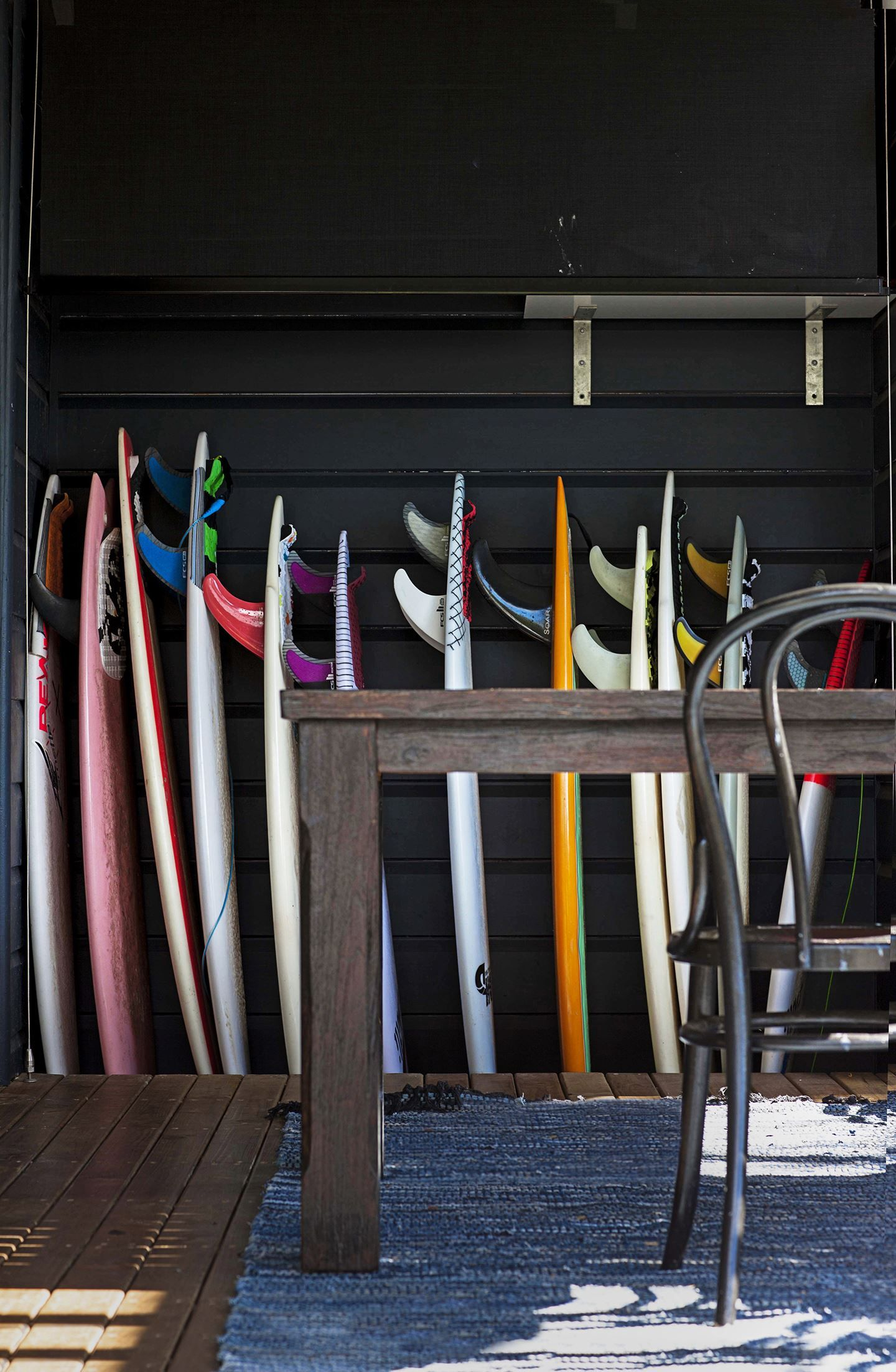 A selection of surfboards lends authenticity to the cool beach style, while also adding bright pops of colour and fun to the back deck.