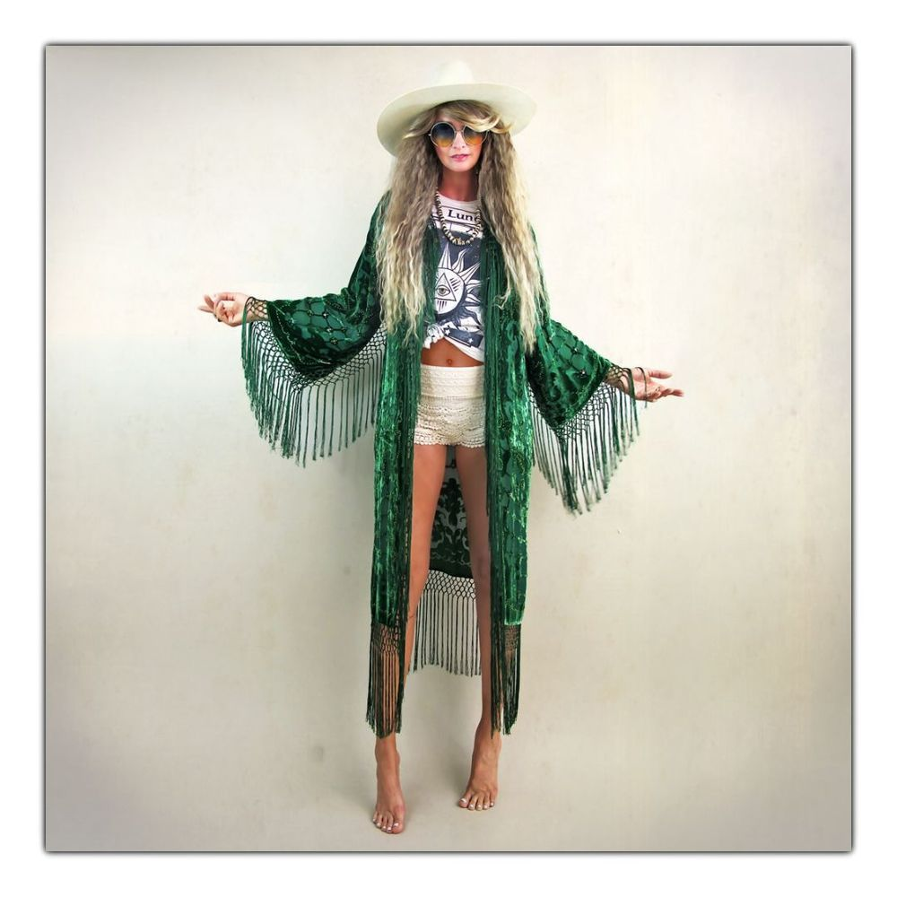 "Seriously stunning emerald green kimono!  Ultra luxe quality velvet burnout with gorgeous hand beading throughout.  Beautiful art deco floral pattern.  Silk fishnet fringe drips down front opening all along hemline and under sleeves.  An effortless, year round piece that can be dressed up or down and treasured for many years to come!One SizeBust goes up to 44"" shoulder 20"" Length including fringe 50""Rayon Velvet BurnoutSilk FringeDry CleanThe v..."
