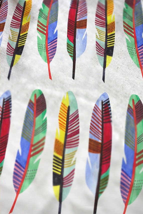 More pretty feather fabric. This one by UK designer Nancy Straughan. Found via True Up