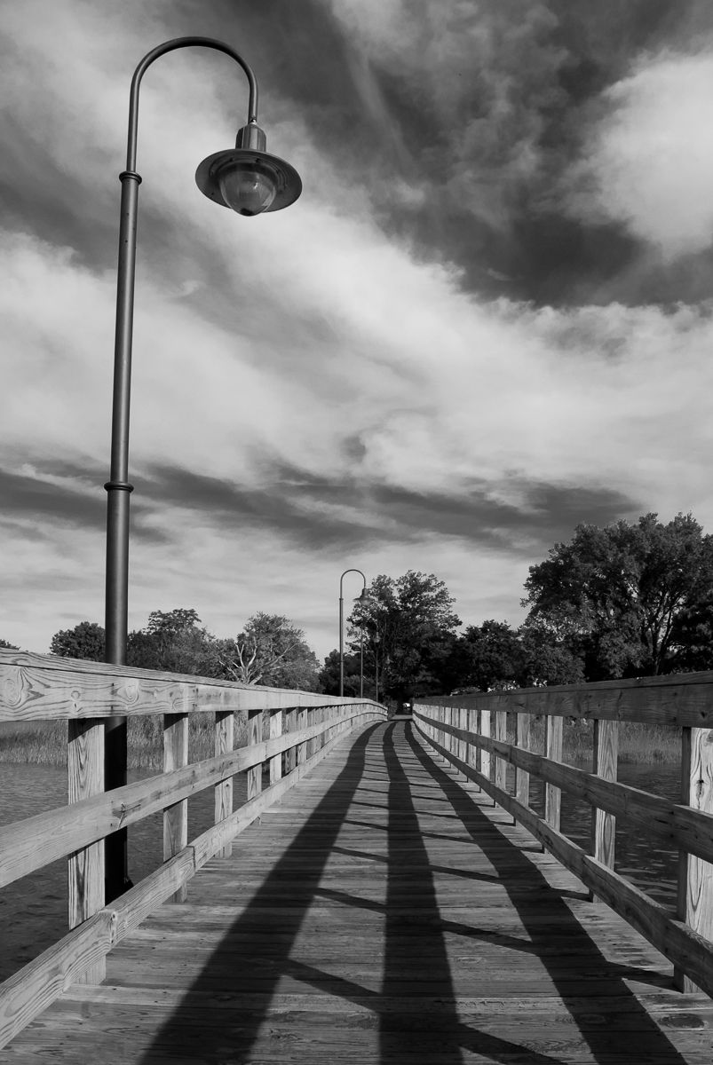 Follow the Lines is a black and white landscape photograph of the old wooden pier at Battery Park located in New Castle, Delaware on the Delaware River. The pier no longer stands, it was washed out by Hurricane Sandy in 2012. Title: Follow the Lines Photographer: Melissa Fague Genre: Landscape Photography Get prints and usage license: pipafineart.com #landscapephotography #landscape #landscape_captures #naturelovers #nature #landscape #landscape_Lovers #EarthOnLocation #EarthCapture…