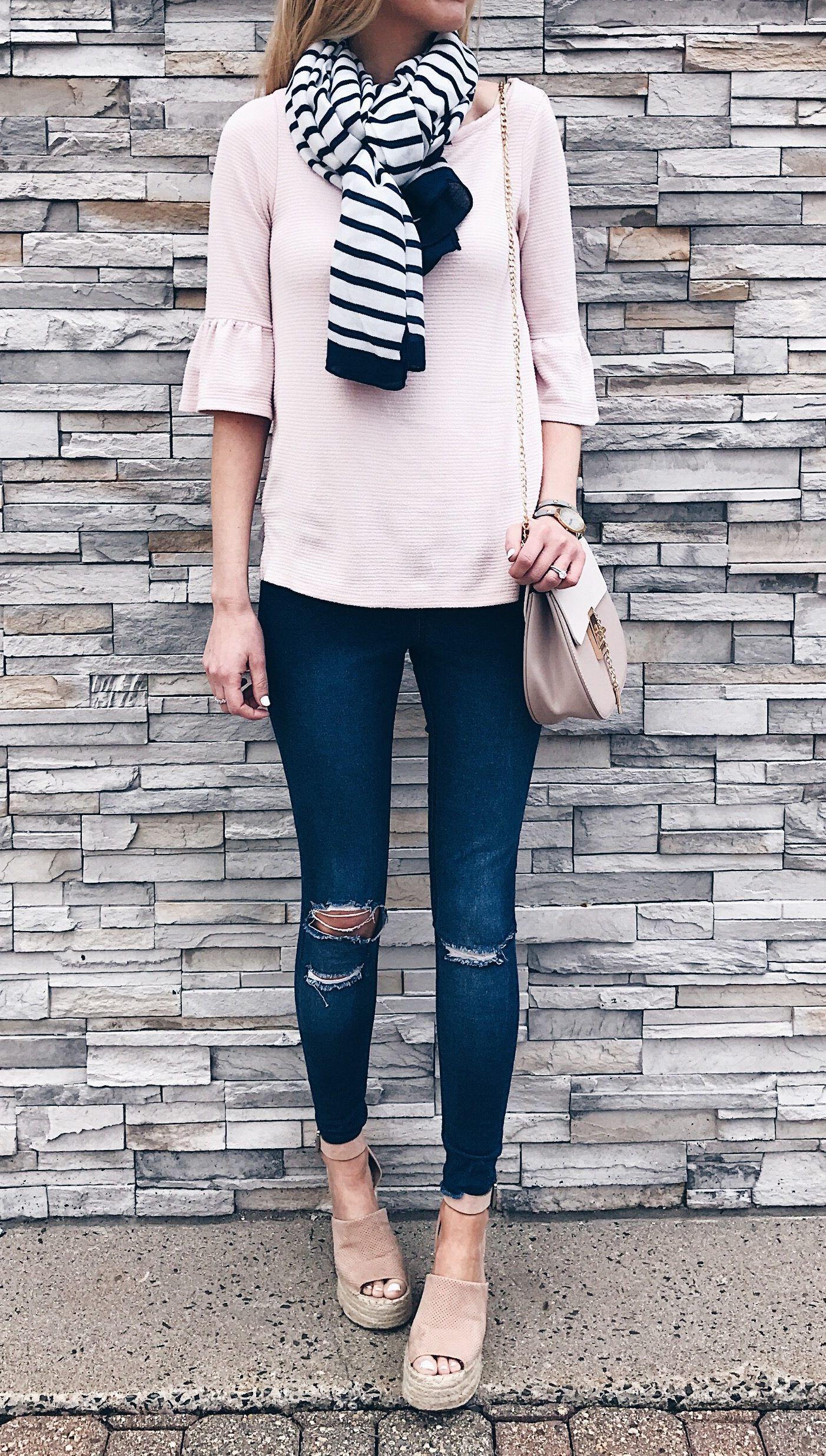 414edd7f4bd spring outfit ideas  pink ruffle sleeve top with jeggings and wedge sandals