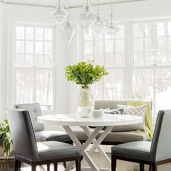 Staggered Glass Jewels Chandelier Over Round Dining Table