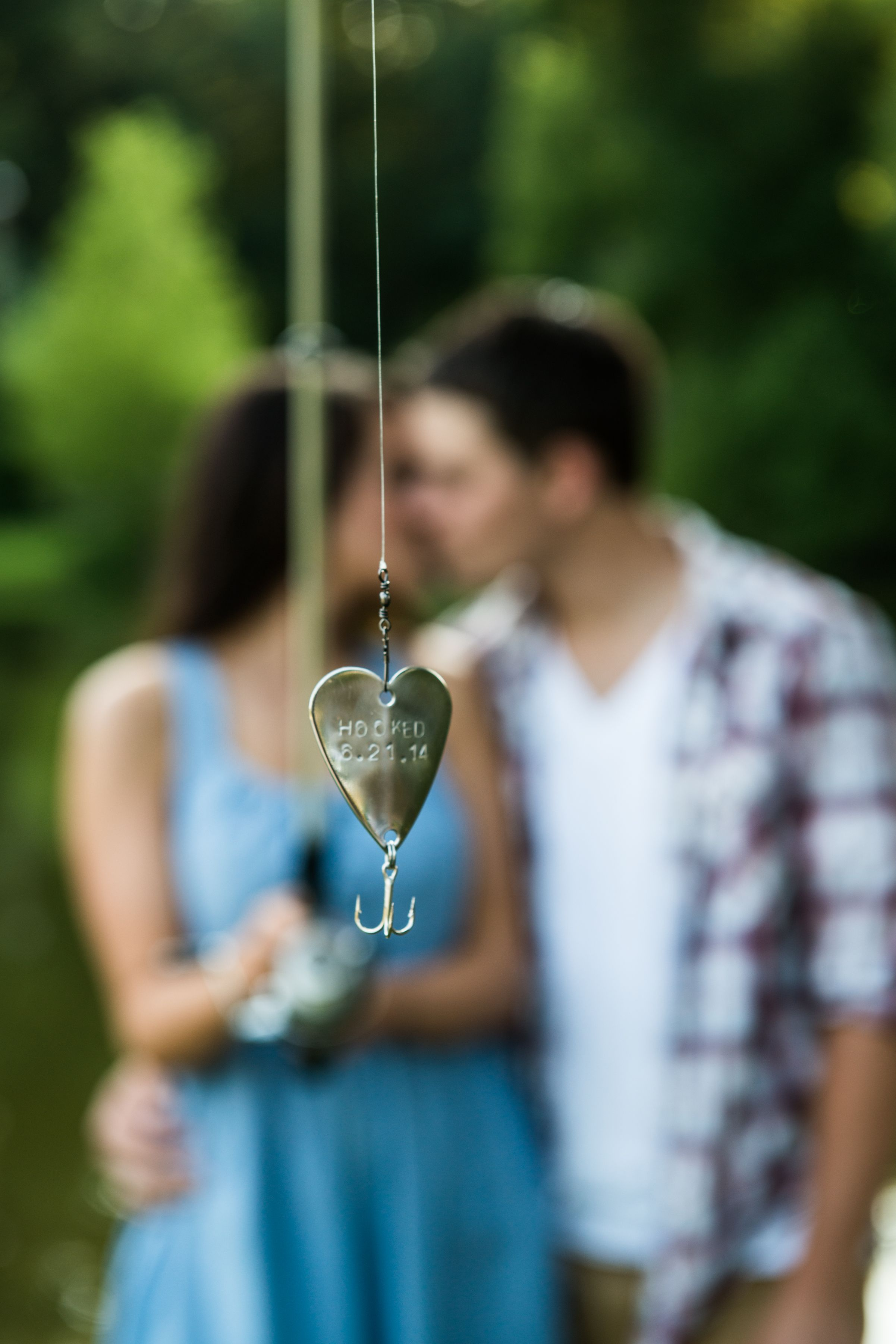 Fishing themed engagement photos bright shot for Wedding ring fishing lure