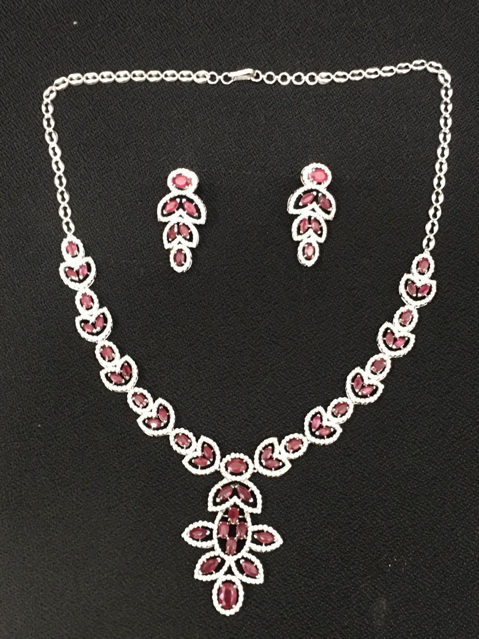 Shop for unique and designer ruby necklaces set from sheetal