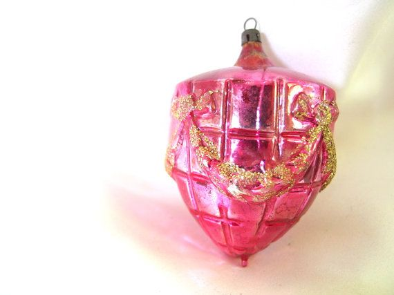 This vintage Christmas ornament is a large hot pink / red textured bauble with…