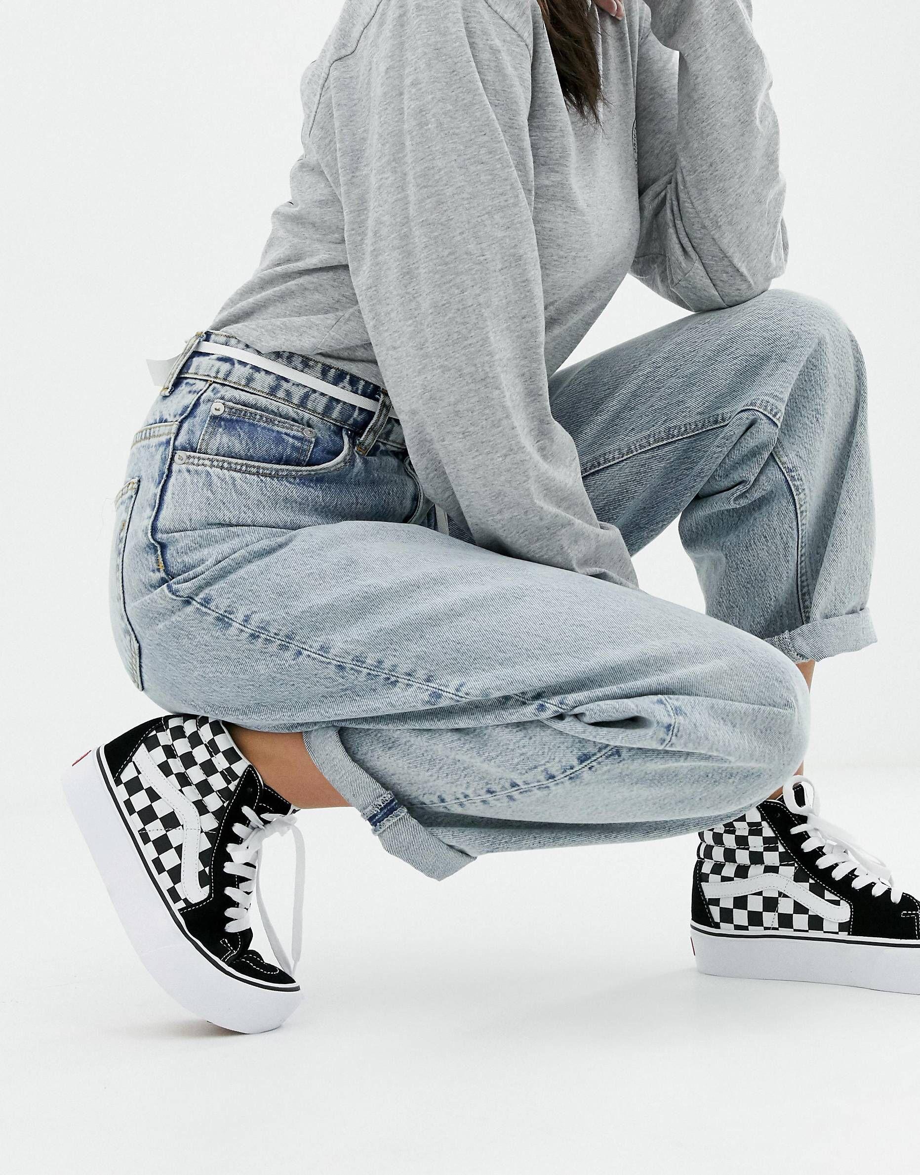 be3da45092 Vans Black Checkerboard Platform Sk8-Hi Sneakers in 2019