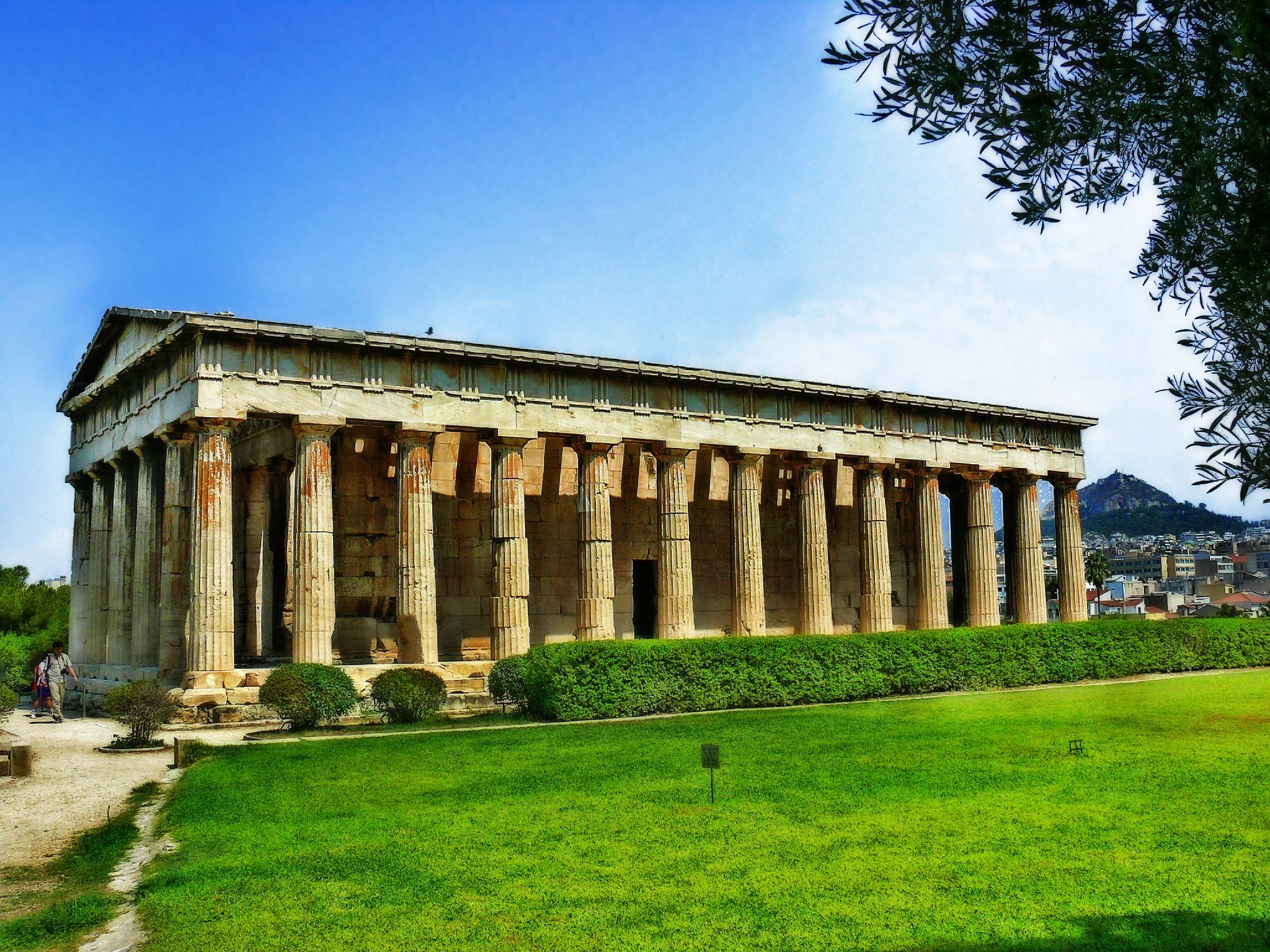 The Temple of Hephaestus 449 BC, also as Theseion after an Athenian hero, is the best-preserved ancient Greek temple; it remains standing largely as built. This temple was the first in Athens to be made of marble and it overlooks the Agora of Athens.  Construction started 2 years before the Parthenon and was dedicated Hephaestus and Athena Ergane, a form of the city's patron goddess responsible for pottery and other crafts.  The project was sponsored by the Athenian politician Pericles.