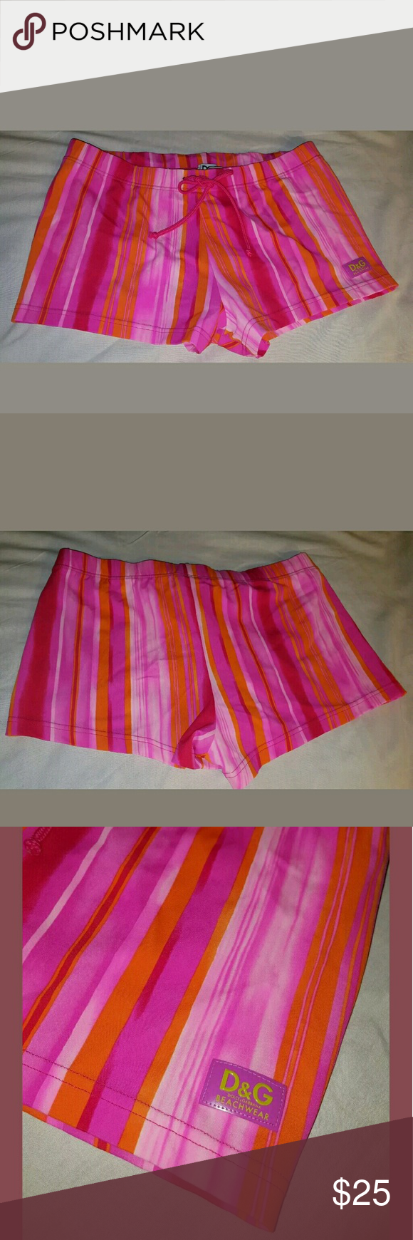 """Dolce Gabbana swim shorts Cute D&G swim short in good condition. Pink and orange stripes, adjustable string on the waist.   Measurements are approximate, lying flat not stretch.       Across waist 14""""      Rise 7 1/5""""         Inseam 2"""" Dolce & Gabbana Swim One Pieces"""