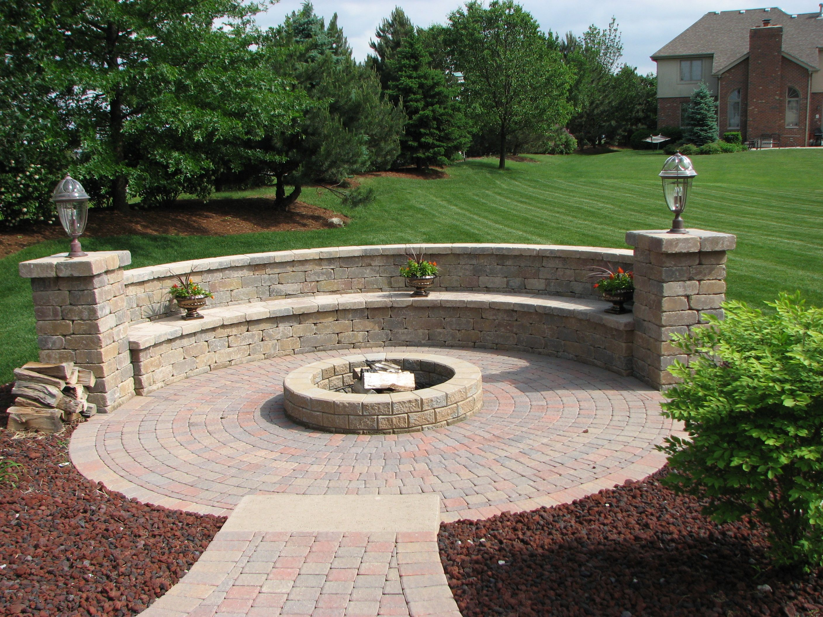 Inspiration for backyard fire pit designs round fire pit for Small stone patio ideas