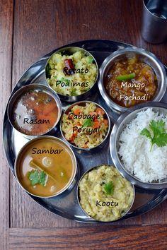 Simple Vegetarian Tamil Nadu Thali by Cook's Hideout Cabbage Poriyal Potato Podimas Kootu Mango Pachadi Tomato Rasam Sambar White Rice