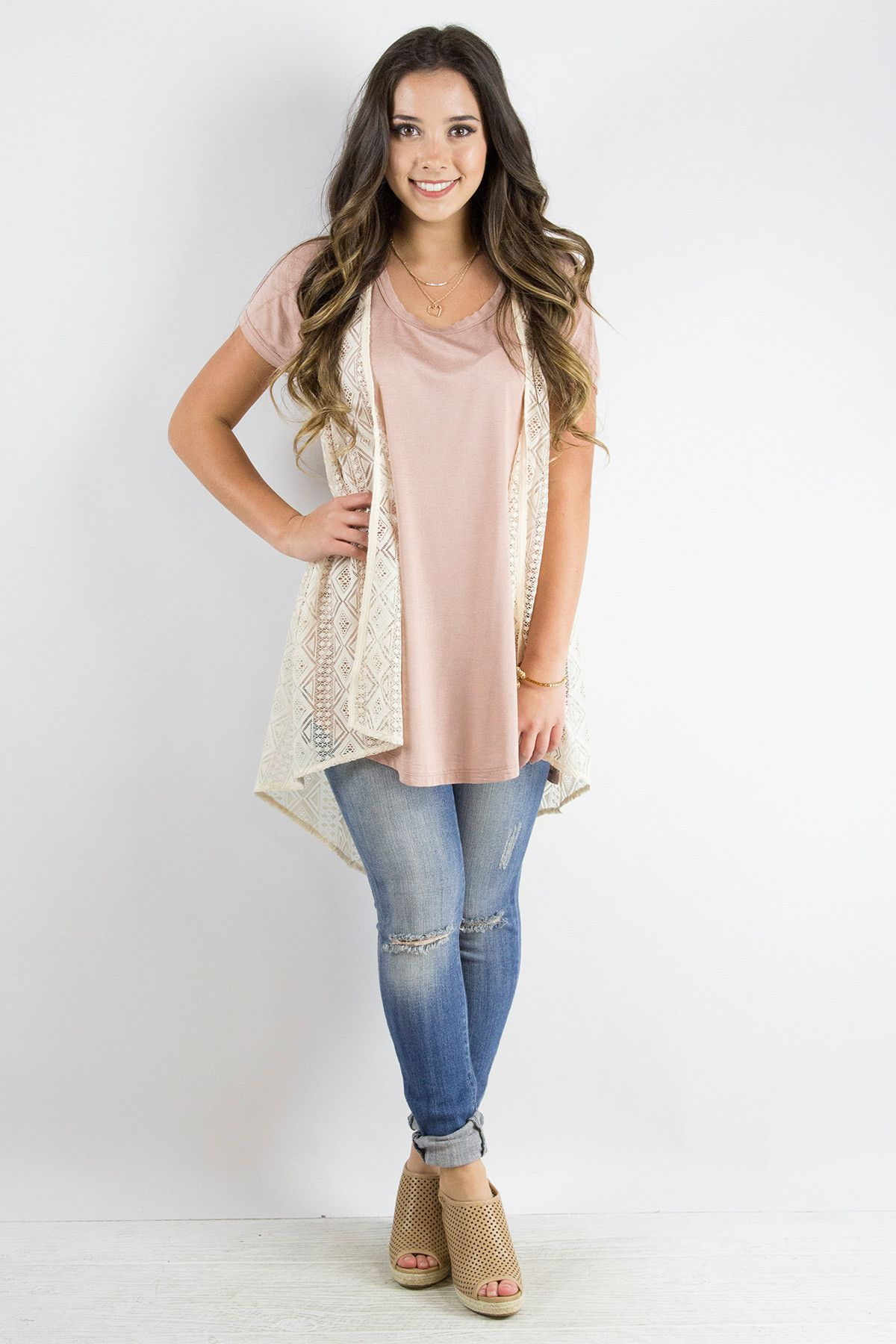 This sleeveless lace cardigan is perfect over just about anything ...
