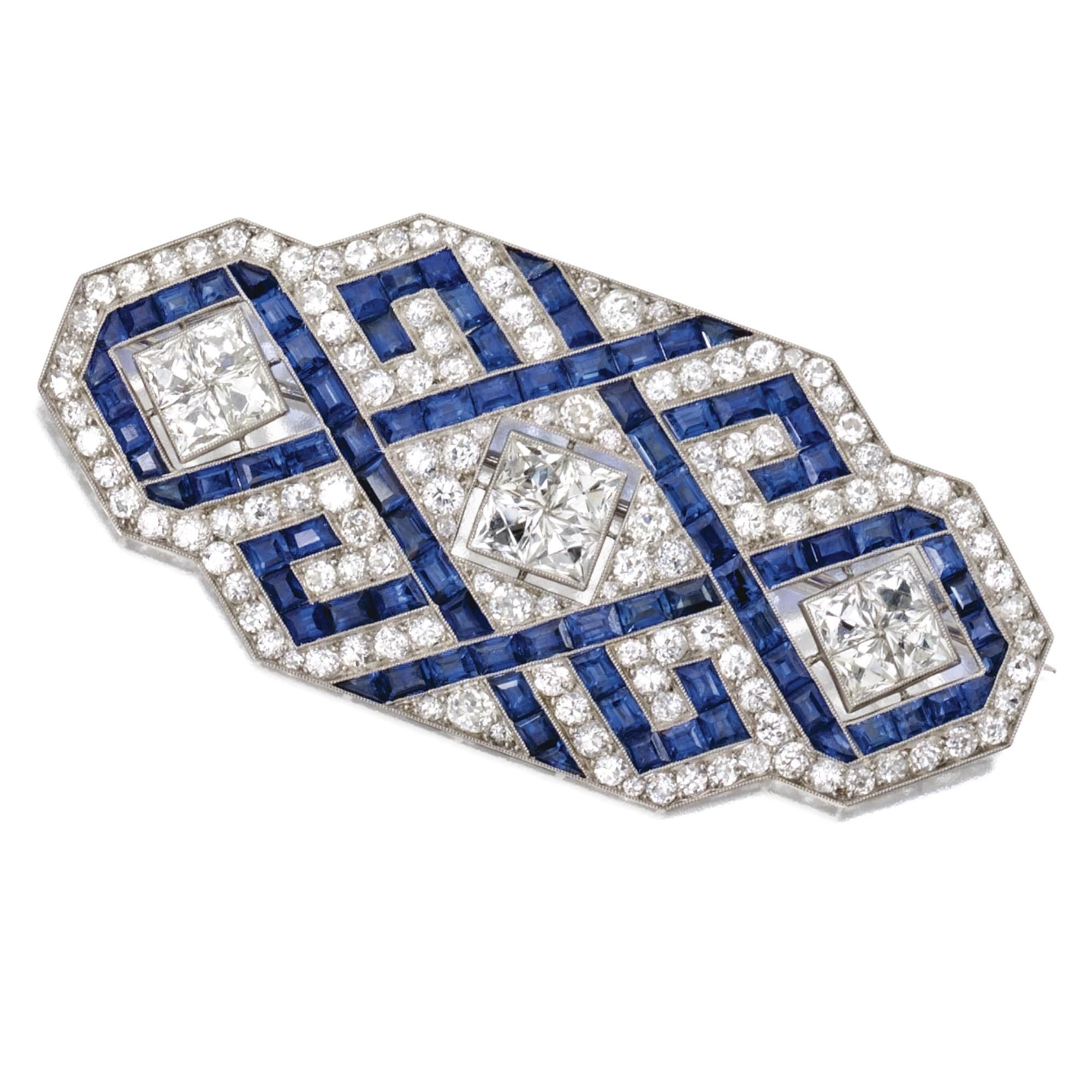 PLATINUM, SAPPHIRE AND DIAMOND BROOCH, FRENCH, CIRCA 1920, Of geometric design set with French-cut, old European-cut and single-cut diamonds weighing approximately 8.00 carats, accented by calibré-cut sapphires, numbered 2387, maker's mark, French assay mark.