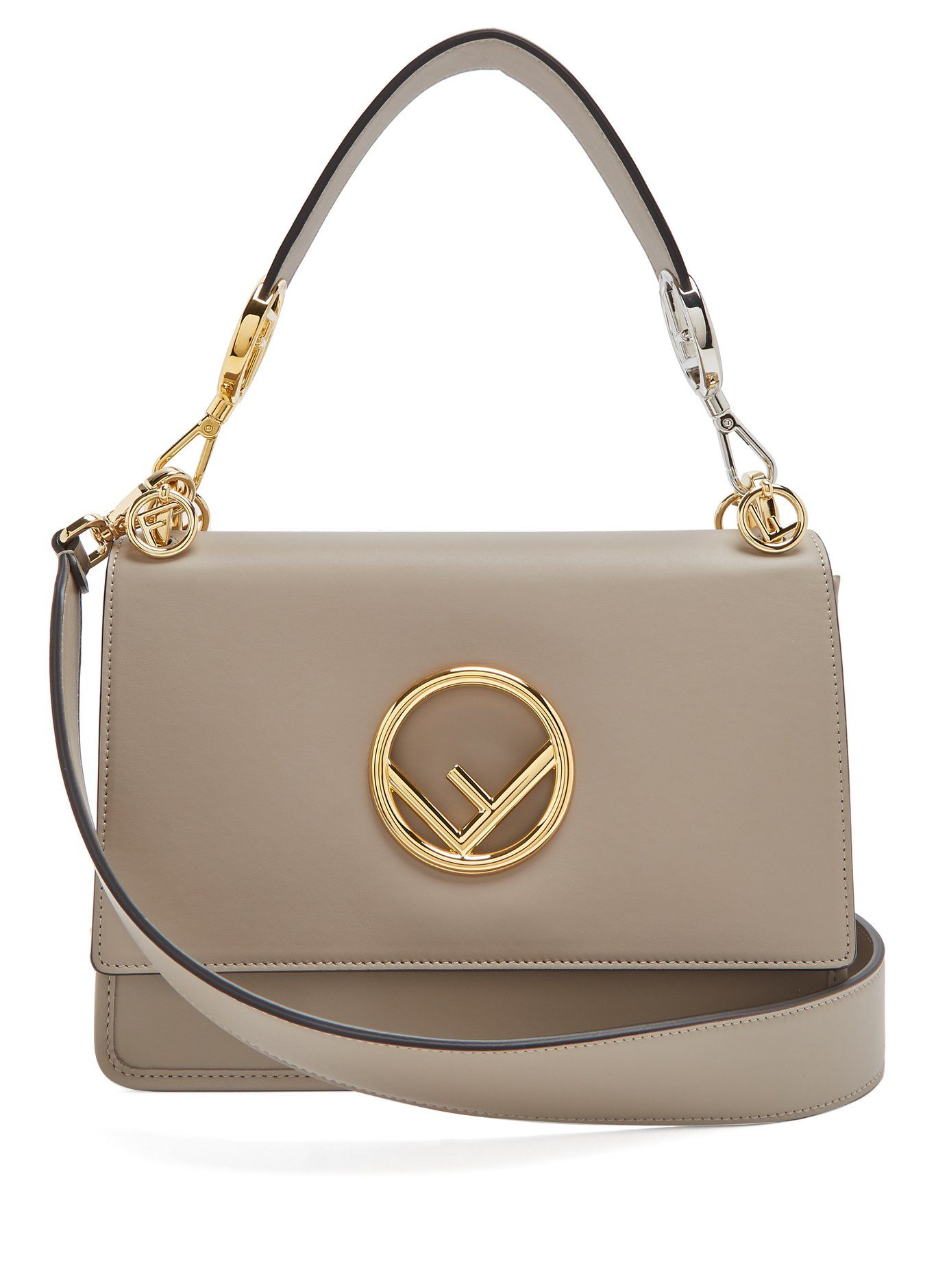 Taupe-grey calf-leather enhances the sophisticated versatility of Fendi s  Kan I Logo bag. It s made in Italy with gold and silver-tone metal  hardware, ... 18749c528b4