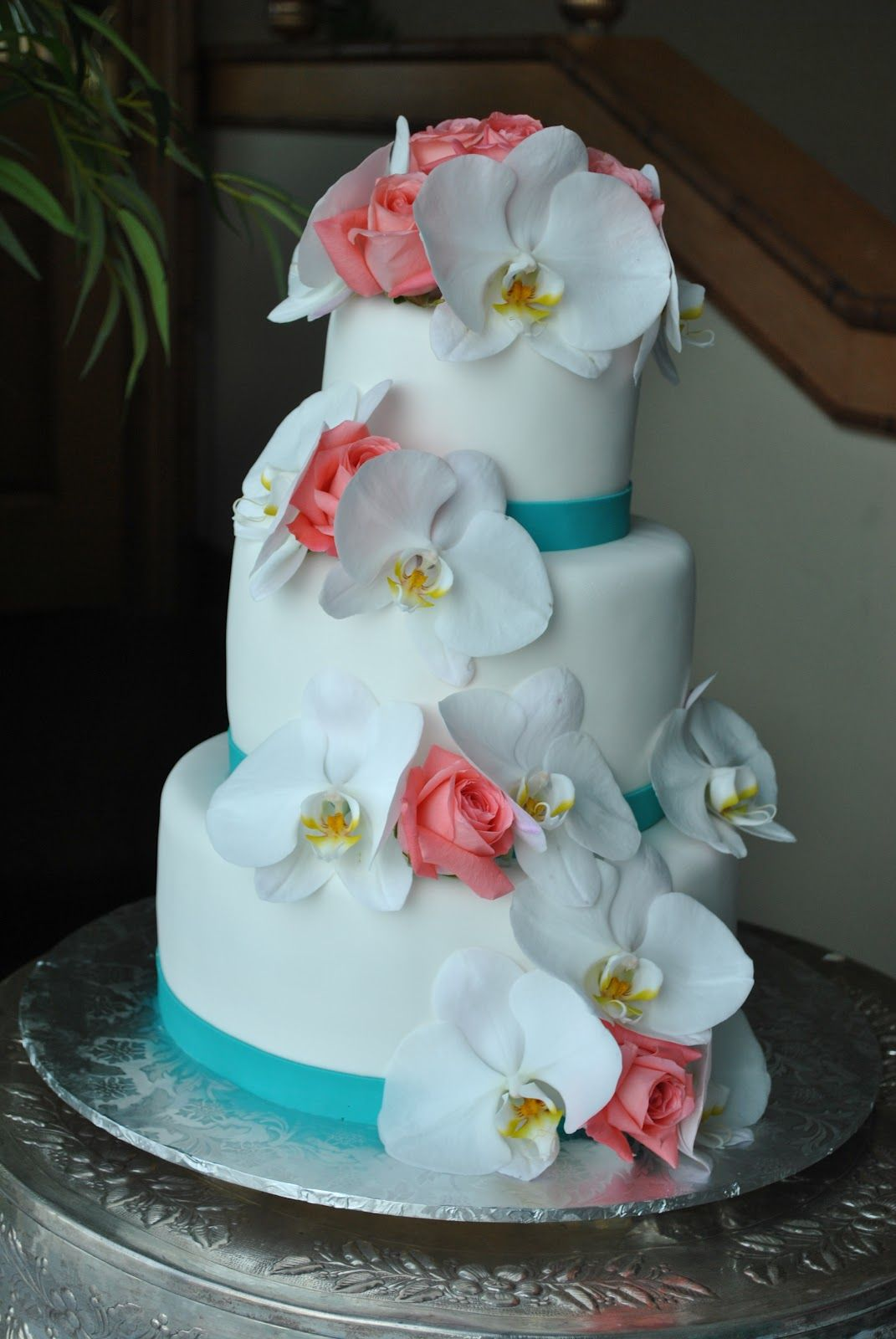White Orchids And Coral Roses Wedding Cake By The Cake Zone