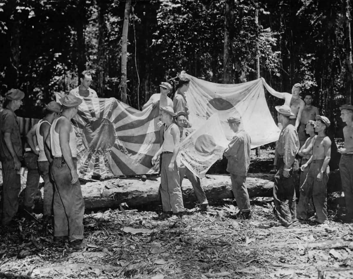 41st Division soldiers with Captured Japanese Flags in New Guinea