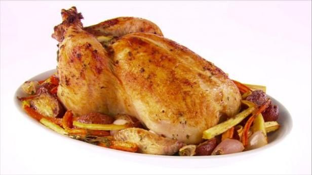 Watch giada at home chicken three ways highlights from food network garlic roasted chicken and root vegetables recipe giada de laurentiis food network forumfinder Choice Image