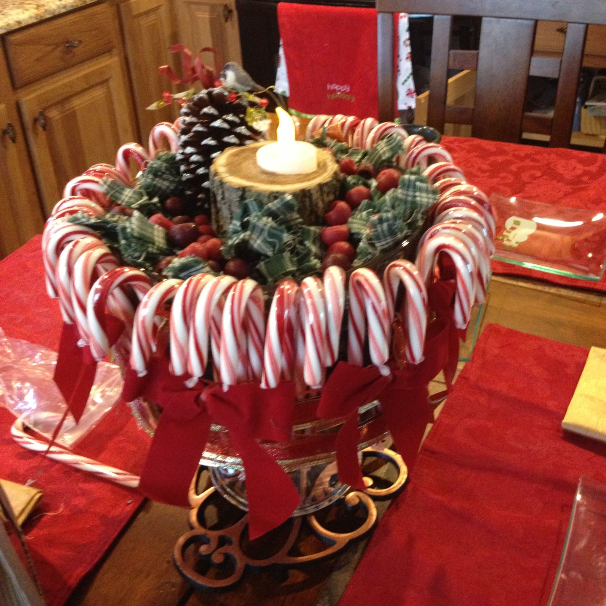 Christmas centerpiece about candycanes attached to a