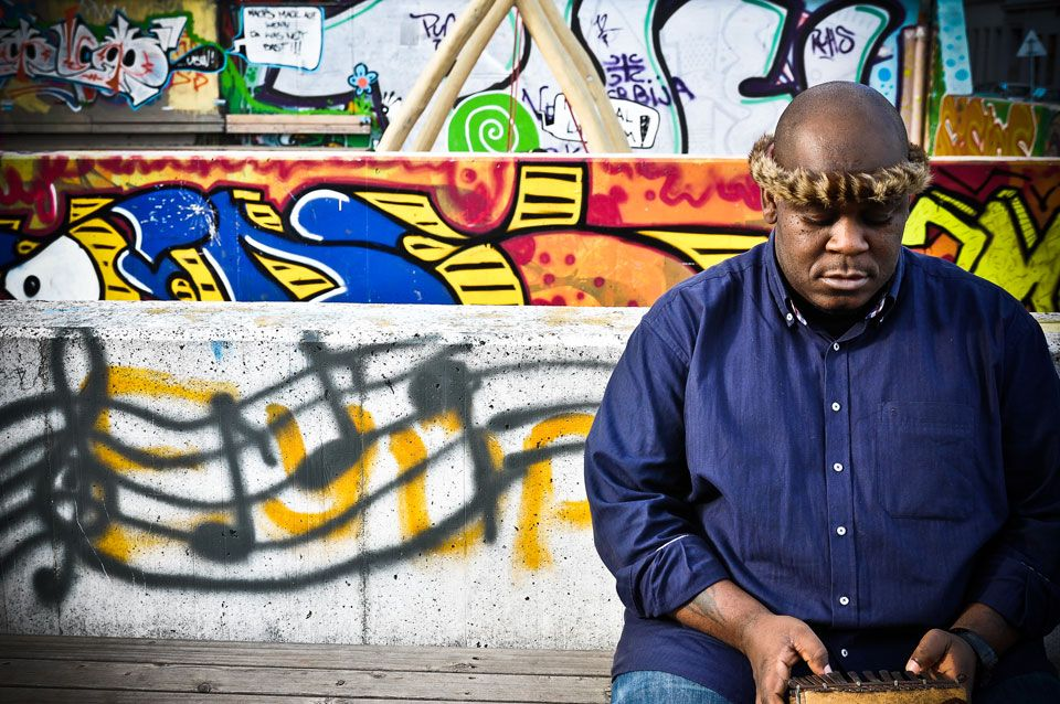 """""""Zimbabwe's Vusa Mkhaya tells his story through his music.  Vusa Mkhaya is a member of the award winning Zimbabwean vocal trio Insingizi and has been described as the future of Zimbabwean Music, with his cool musicality and sharp lyrics that capture the life and experiences of an African musician living in a fast and ever changing world. An accomplished songwriter, Vusa tells his story in a manner and style that not only epitomizes his love music, but his identity as a master of African…"""
