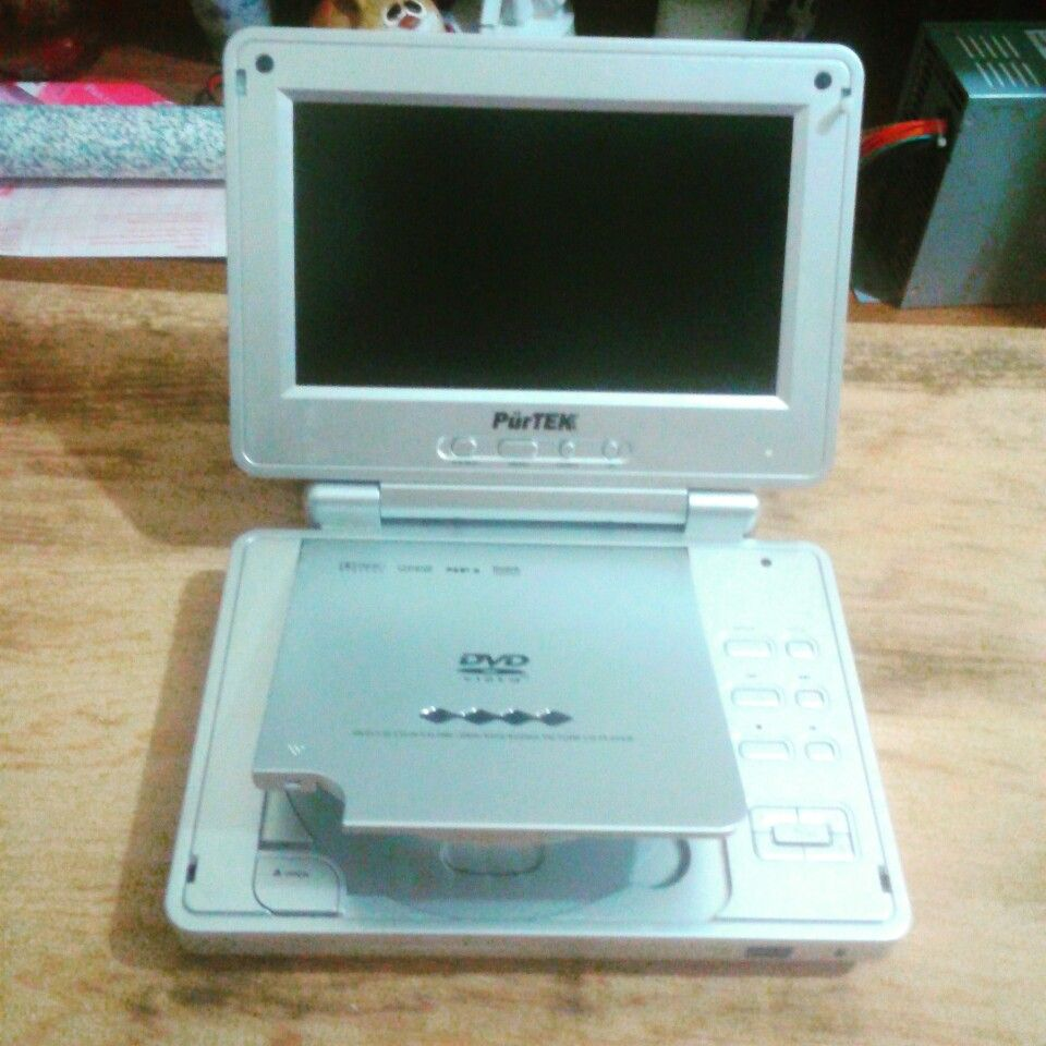 Portable dvd player with no charge cable. Gunna have to open it up ...