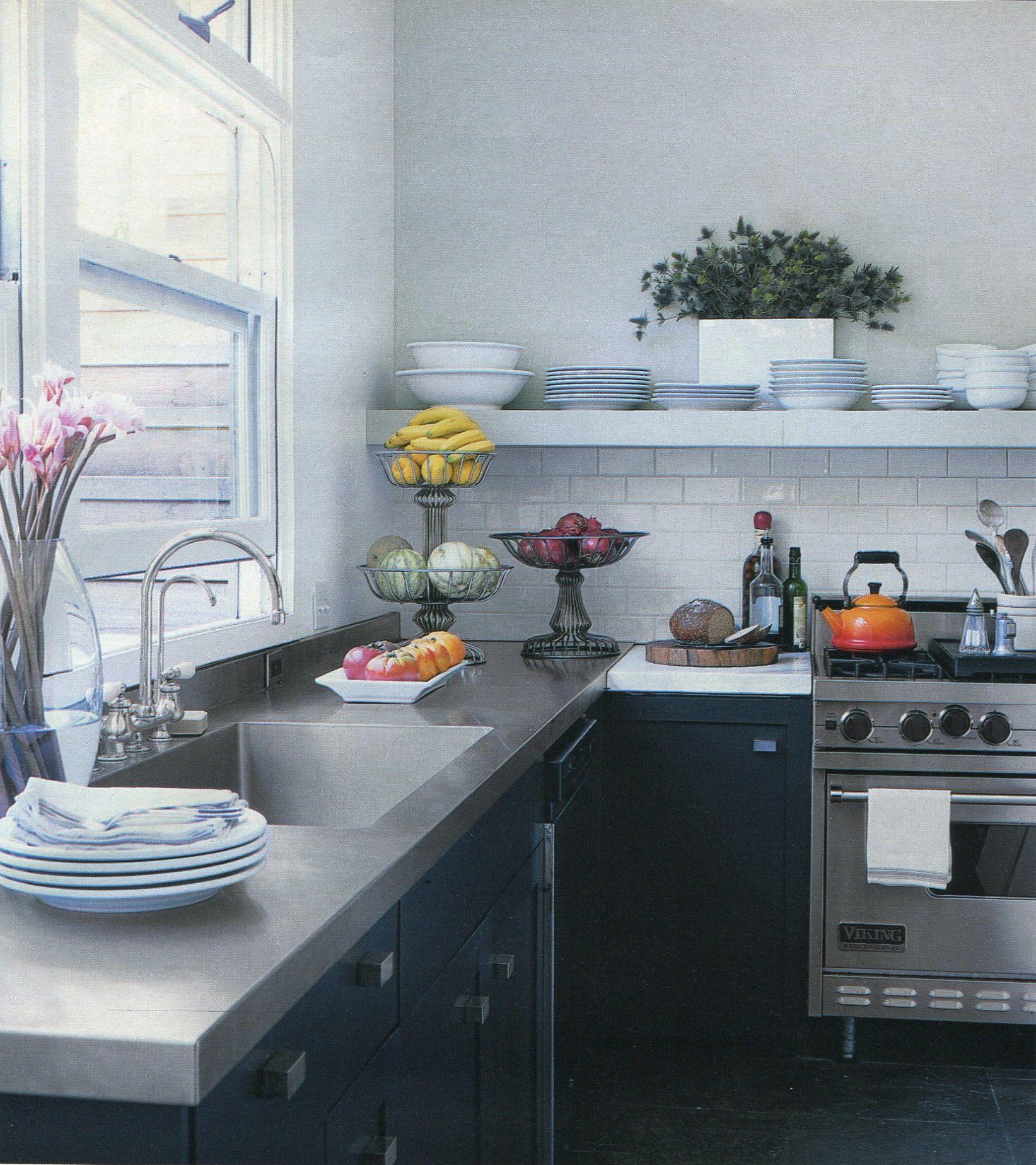 I love stainless steel counter tops & exposed shelving.   Dream ...