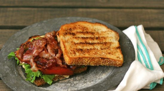 Fancy BLT: pancetta, escarole, balsamic-roasted tomatoes and sourdough. The mayonnaise gets a boost from a touch of cr�me fra�che and vinegar.