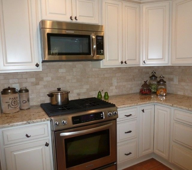 colonial gold granite and tumbled travertine backsplash