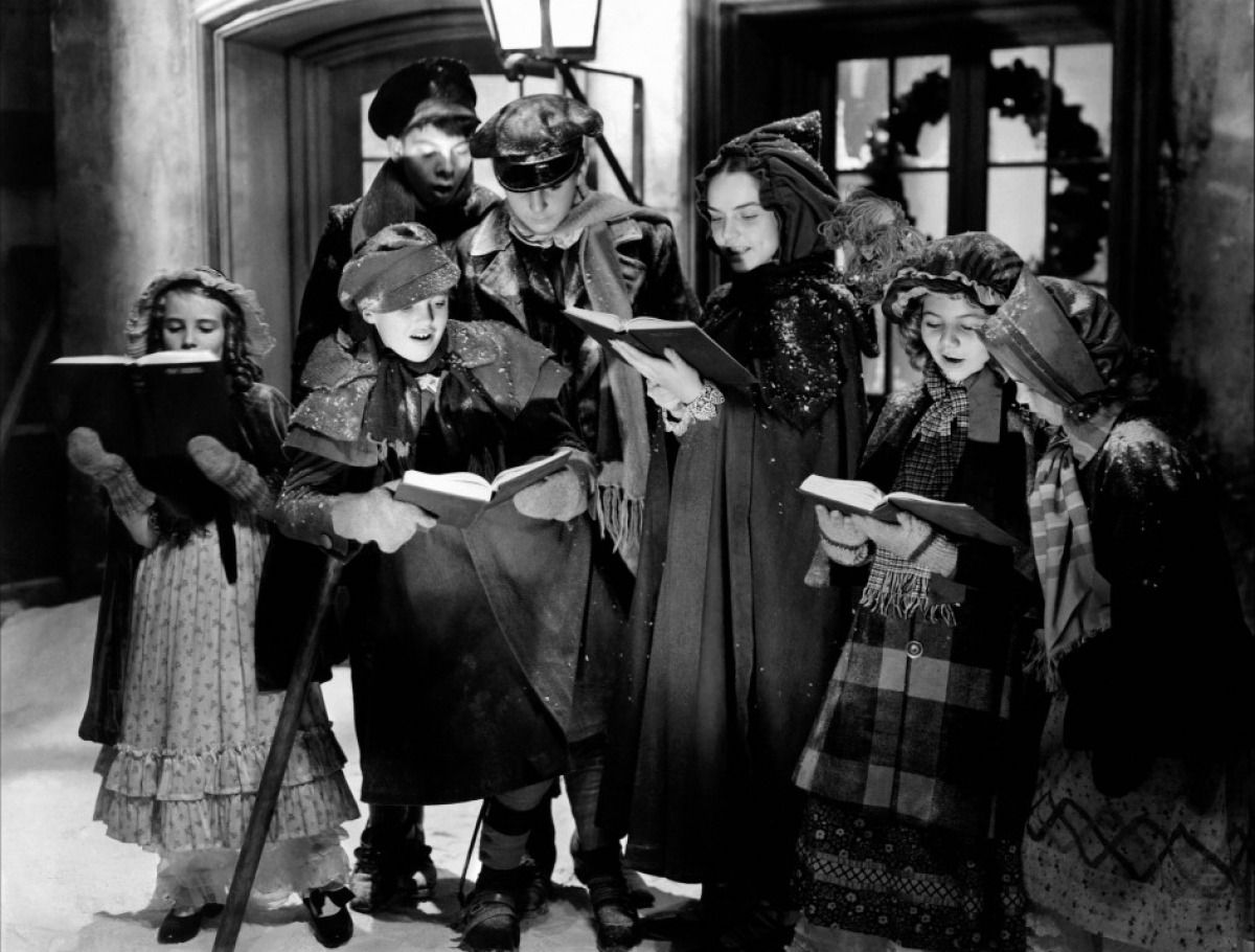How apropos some of the Cratchit children singing carols