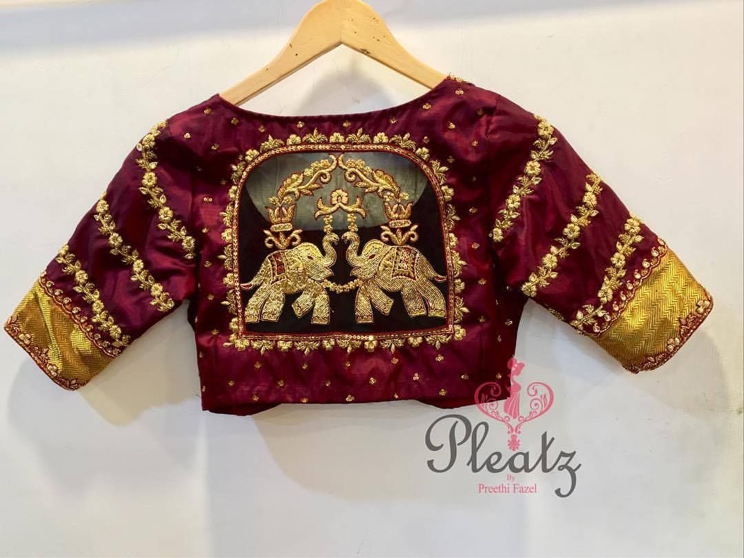 1d55c28d23ef7b We love the little details in this design. Beautiful bridal maroon color  designer blouse with elephant design hand embroidery gold thread work.