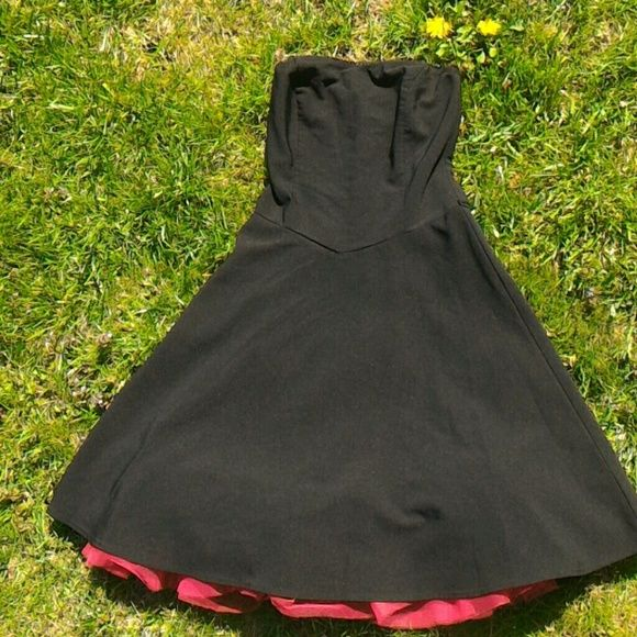 Black and Red Rockabilly Dress This strapless fit and flair dress comes with its own red crinoline. The label says size 7 bit it fits like a size 4. Ruby Rox Dresses